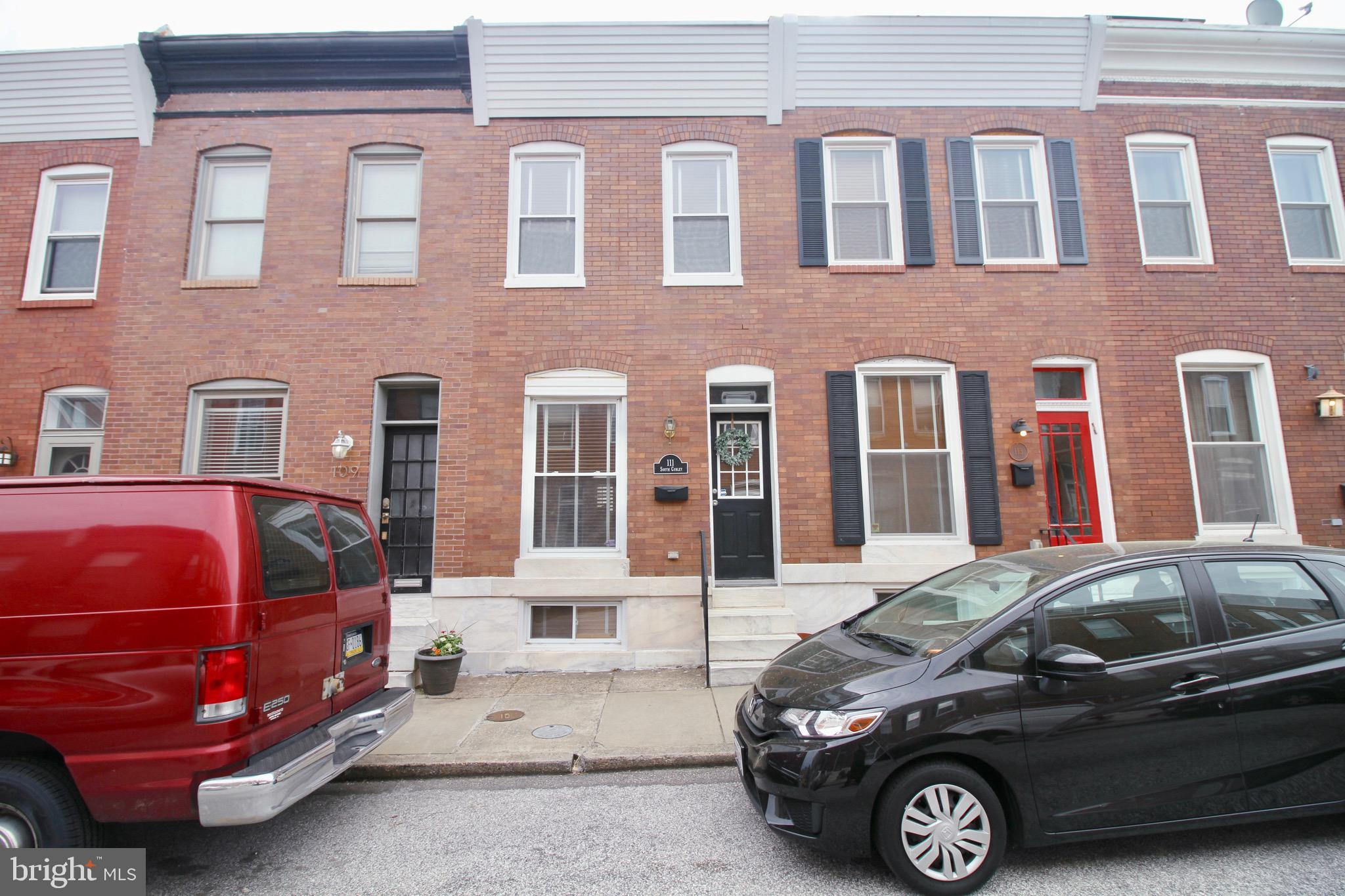 Outstanding value for a well-maintained, lovely Patterson Park brick row home with 2 nice sized bedr