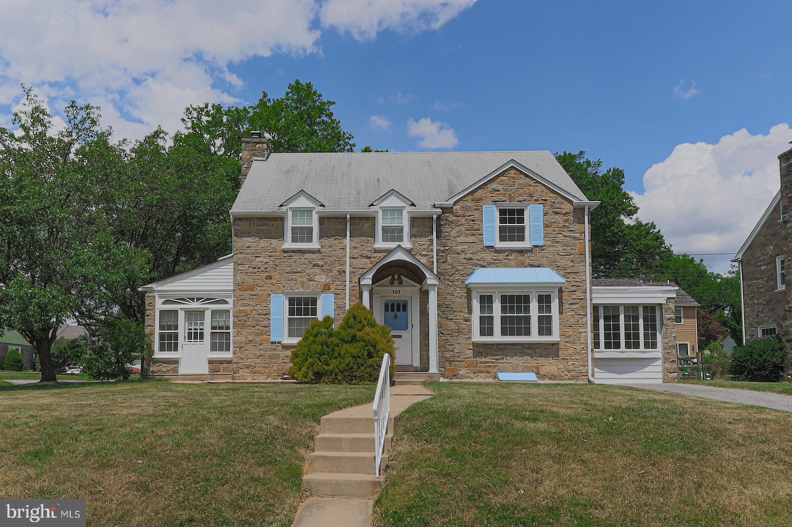 This charming home situated on a premier corner lot and on a picturesque street will surely capture