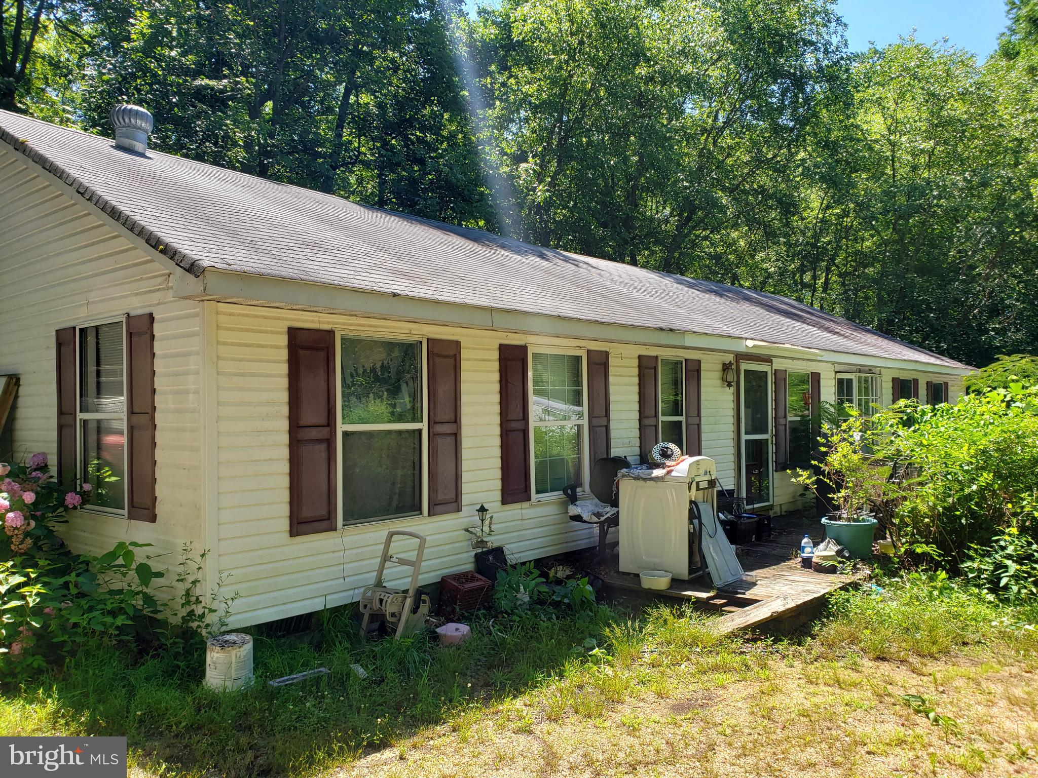 COMING SOON!  Just over 5 acres.  Manufactured home on property with rehab potential.  AS IS