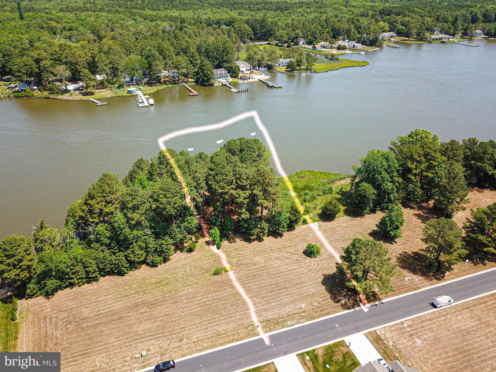 Buy this beautiful waterfront lot in the premiere golf community of Glen Riddle and you are purchasing a piece of history. Riddle Farm, which is now the Glen Riddle community, was once the most important horse training center in the nation. The greatest horses of the 20th century, Man o~ War and War Admiral, once galloped where golfers now play. The stable, built to house 60 horses, was carefully renovated and is now a Ruth~s Chris Steak House restaurant, its walls filled with photos and memorabilia.This lot has approximately 90 feet along Turville Creek. It also shares, with the lot to the left, what the owners were told are the ruins of the equine therapy pool. Today it would make a great spot to launch a canoe or kayak. Who knows how many great thoroughbreds walked this very ground?Build your dream home here and enjoy all that Glen Riddle has to offer: a gated resort-style community with a private marina, owners~ clubhouse, two 18-hole championship golf-courses, swimming pool, tennis courts and more. It is ideally located near historic downtown Berlin, Assateague Island Park, and the beach attractions at Ocean City.
