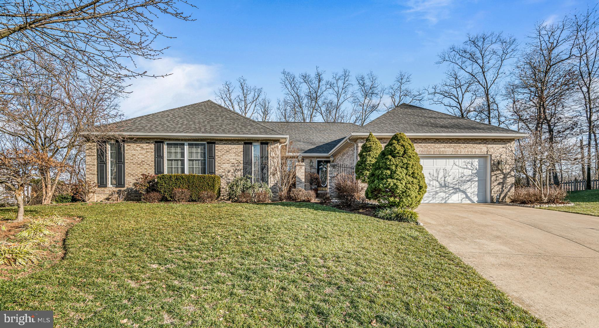 This spacious home features main level living with a fully finished basement with tons of storage.  2019 Upgrades include - New Roof, New Hardwood Floors on Main Level, New Refrigerator, New Upgraded Gas Cooktop, New Shower in Master Bath, Fresh Paint on Main Level, New  Carpet in Basement.  Other features of the home include Gourmet Kitchen, Large Sunroom off of Kitchen area, Skylights, Irrigation System, Deck off of Main Living Area and Patio on Lower Level Walk-out, Extensive Landscaping, Water Softner.  Rough-in for additional Kitchen in Basement.  One area of the basement is currently furnished as a salon.