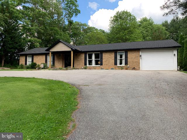 The circle driveway welcomes you to~Beautiful rancher with updates and upgrades throughout and sits