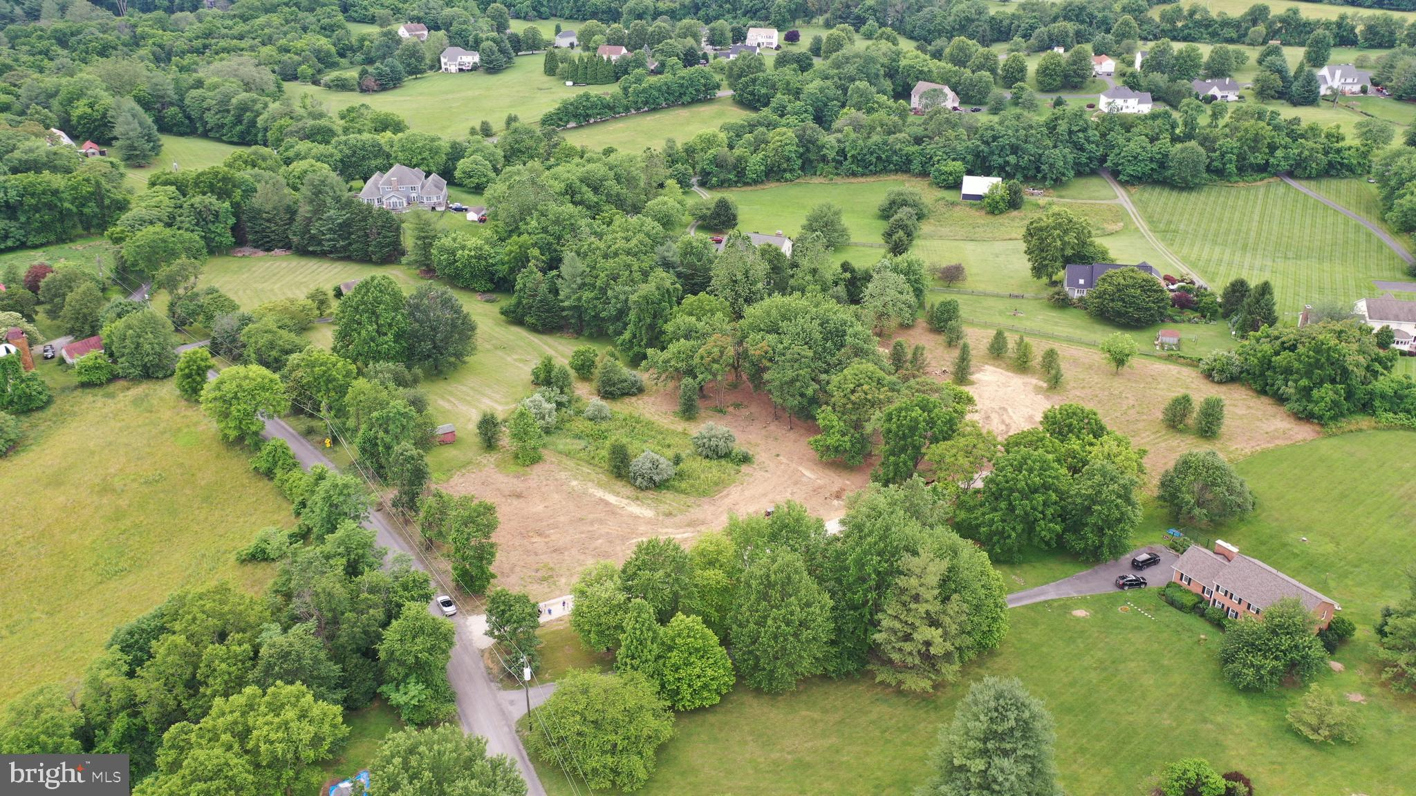 Build your forever home on this beautiful and rare 3 acre lot, approximately 2 miles from town, partially wooded with gorgeous sunset mountain views!  Serene, park-like setting with portions of the lot containing mature trees, remainder of site groomed, including house location site.  Gravel driveway installed.  High speed internet and cable TV available, installed well, 4 bedroom septic perc approval (2 drain field locations available).   All property corners and main drain field location are clearly marked.  This lot is ready to go!
