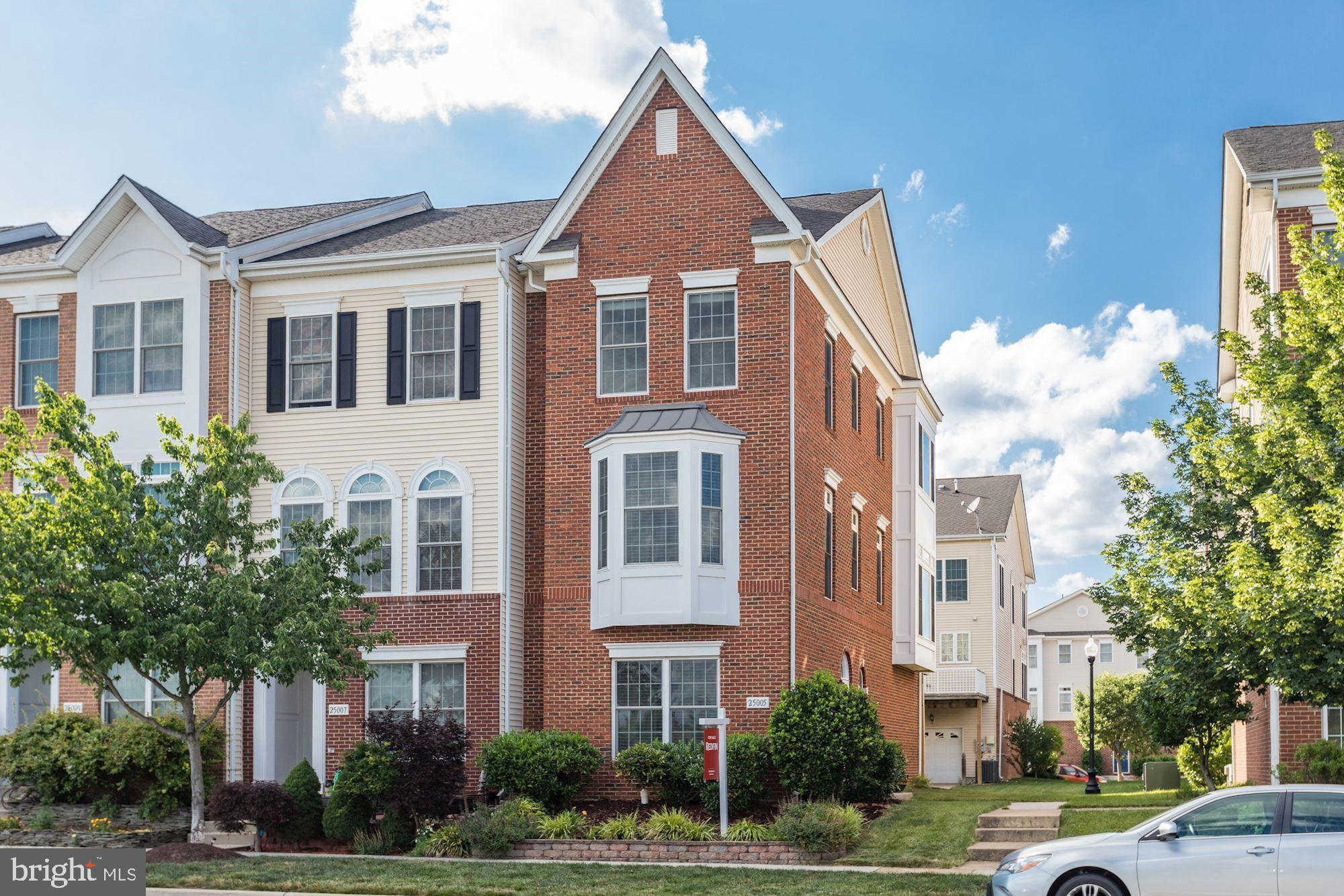 Light and bright, this one car garage end unit townhome in South Riding does not disappoint!   Ideal