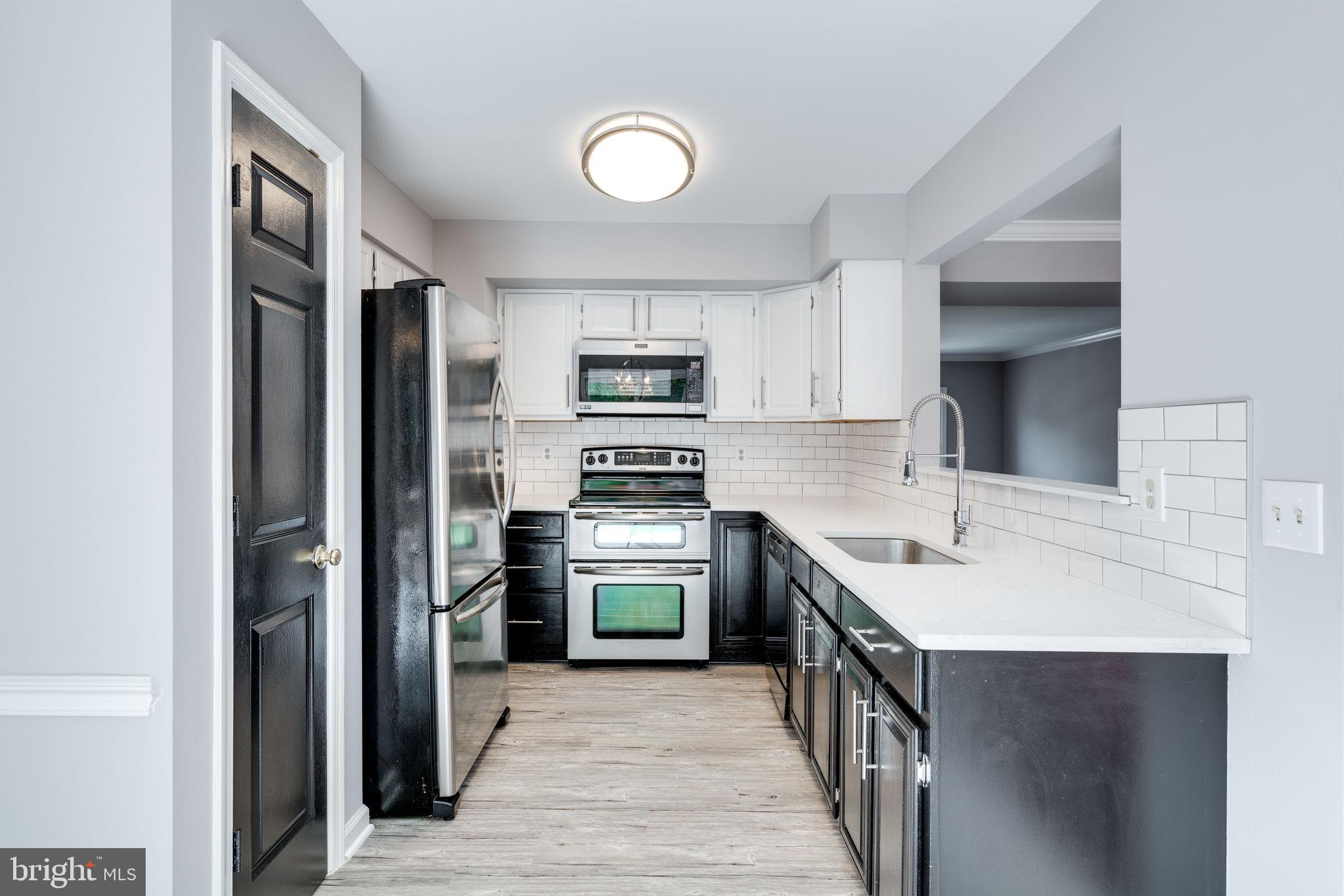 Priced to Sell Fast!! Renovated Brick Front 3-Level Townhouse in Lake Ridge, 1 Car Garage, Updated K