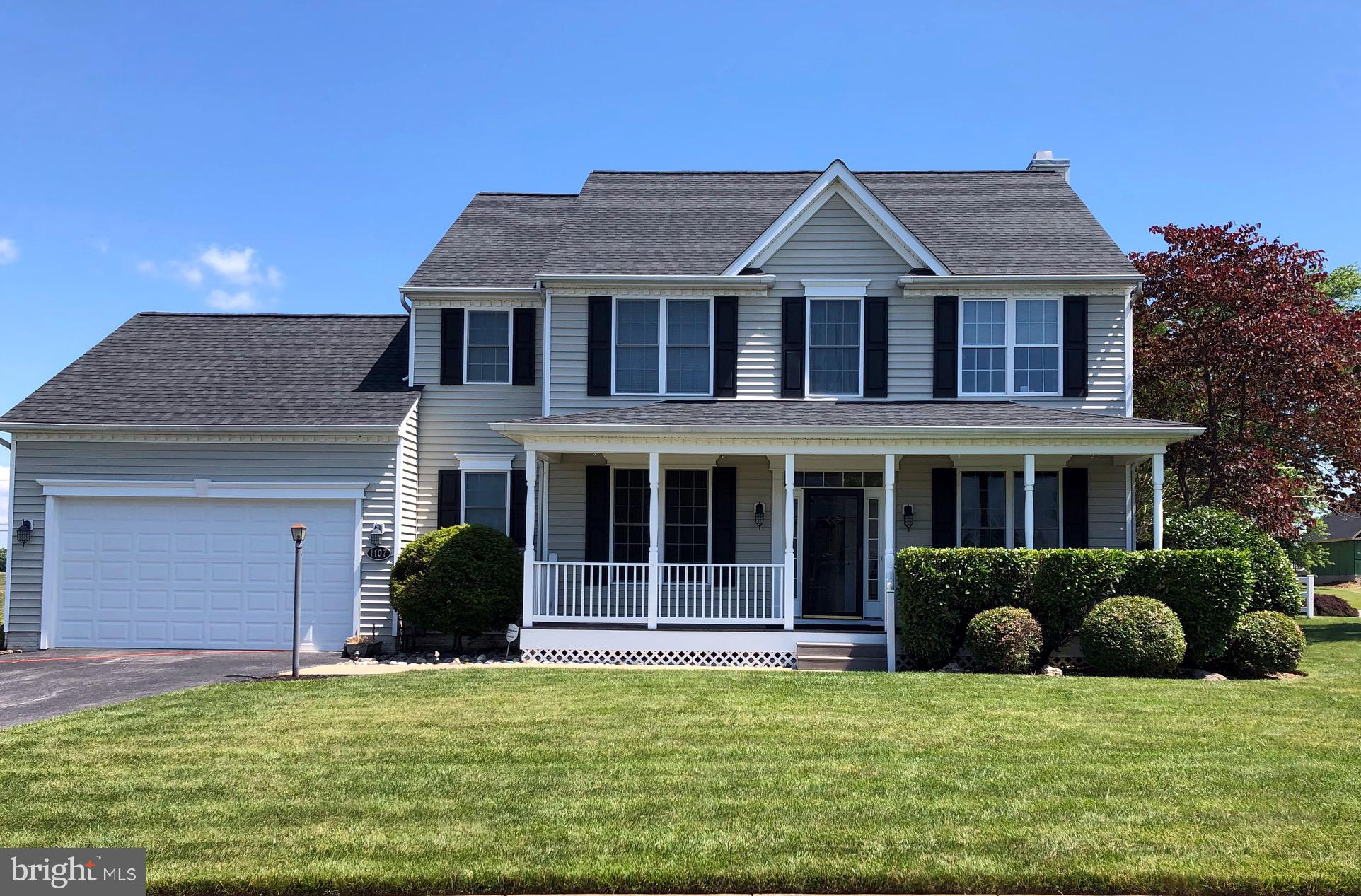Beautifully maintained colonial with front porch and rear deck on level lot.  Updated kitchen opens