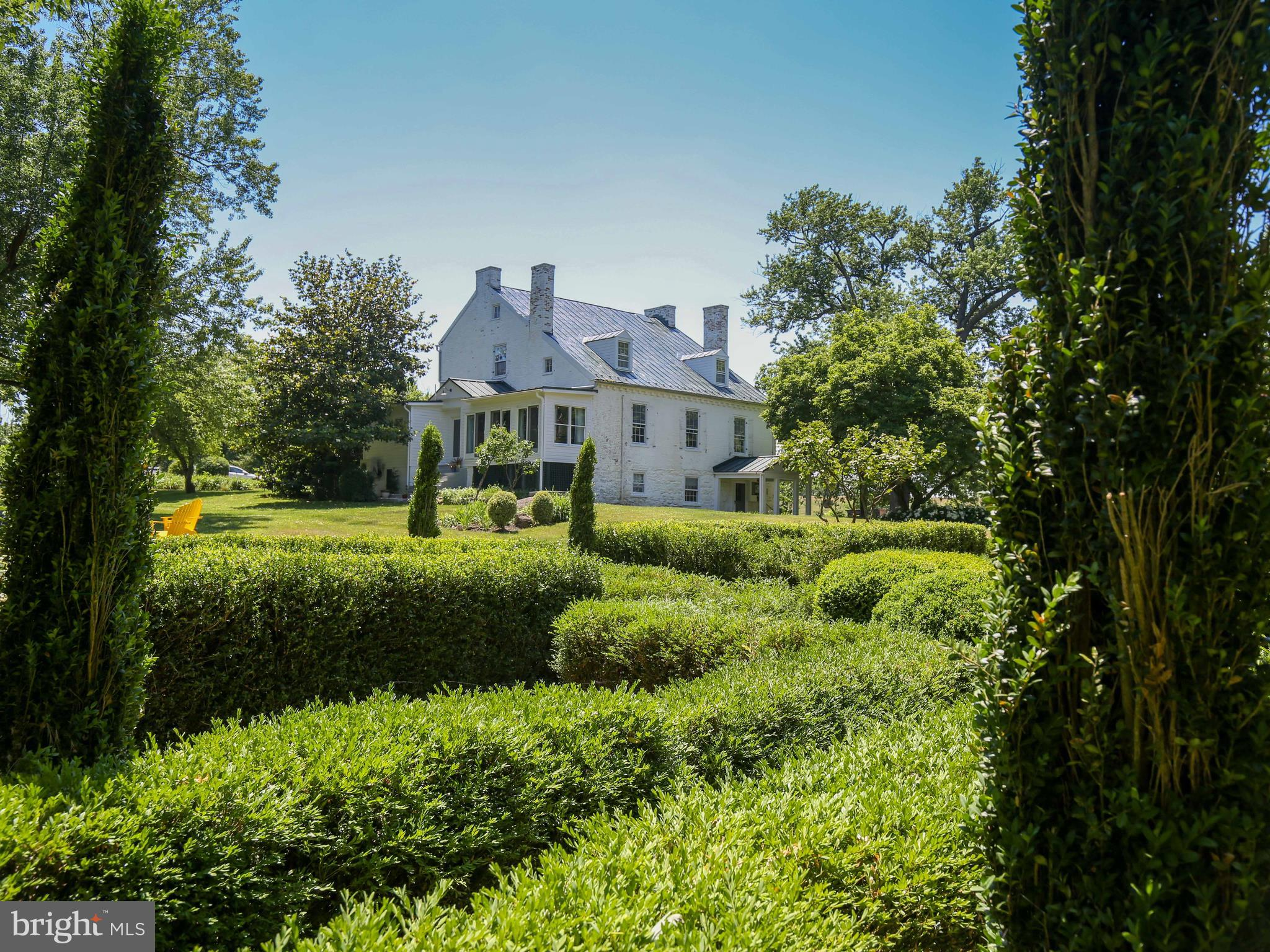 Welcome to historic Rock Spring, a gracious brick home built in 1790-1810 with formal gardens and fi