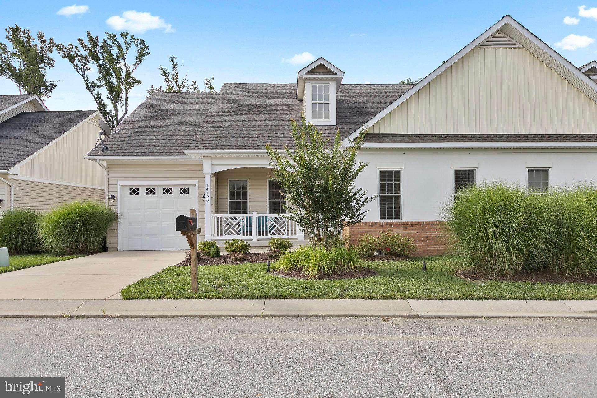 Former model home!! Gorgeous and completely upgraded! Wood floors throughout! Modern white kitchen w