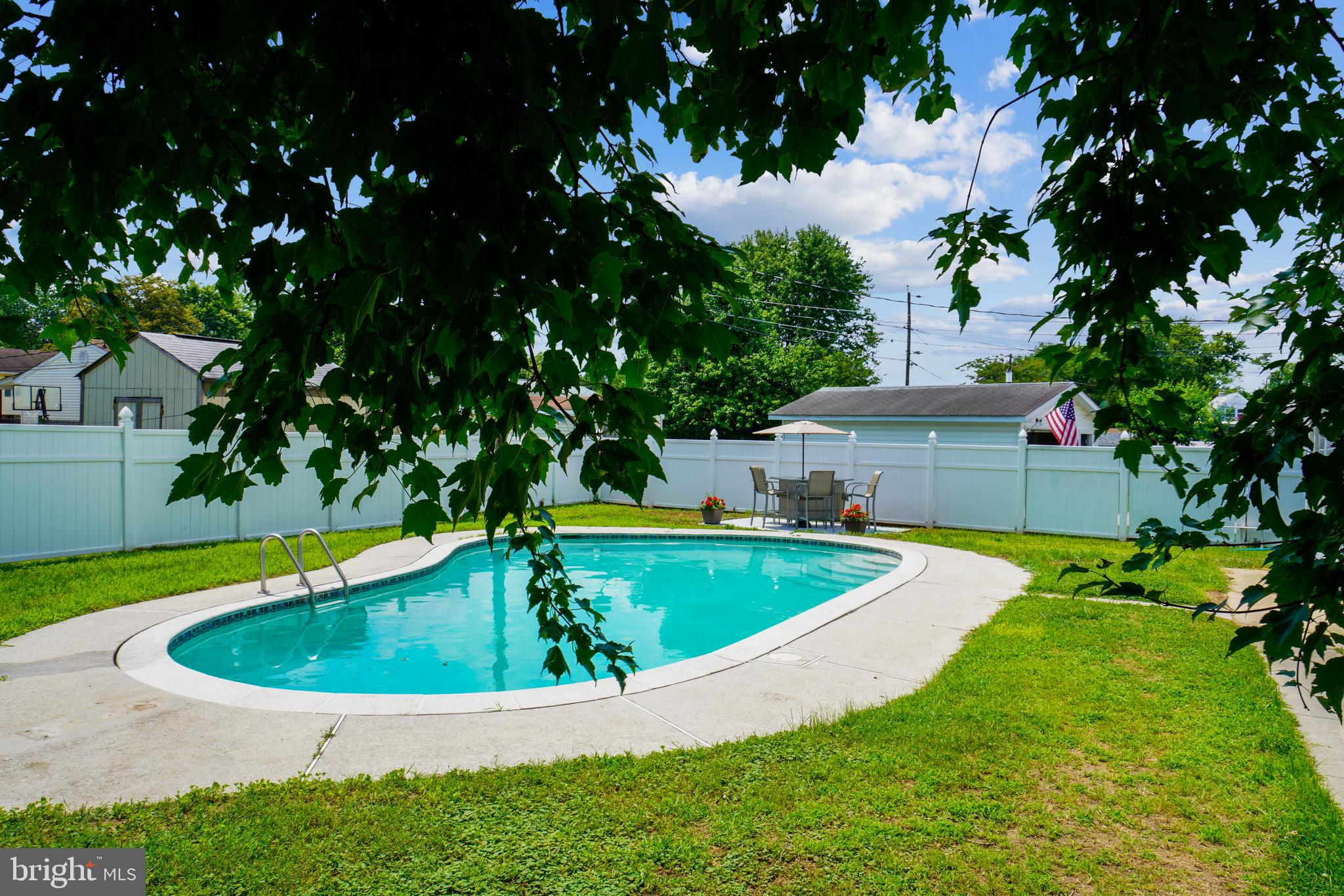 Great house for these hot hot summer days, cool off in your...IN-GROUND 30,000 GALLON POOL with privacy fence & lighting for dramatic and fun evening swimming~Great way to beat the heat and cope with Covid-19 quarantine~POOL  will extend swim season well beyond Labor Day~Added plus... spacious windowed/screened OUTDOOR PARTY ROOM ADDITION - perfect for crab feasts, outdoor dining under cover,  fun for card games and puzzle making or dance/tik-tok parties while sheltered from inclement weather~PLUS...NEW LAMINATE FLOORING  in bedrooms and lower level~FRESH PAINT THROUGHOUT in June 2020  (ceilings, walls, trim, kitchen cabinets,, and closets!)~NEW VANITIES , FAUCETS and FLOORING in bathrooms~NEW COOKTOP and COUNTERTOPS and BACKSPLASH in kitchen~NEW ROOF August 2019 and NEW HVAC SYSTEM November 2019 (both with transferable warranties)~NEW VINYL THERMAL  WINDOWS at FRONT and  SIDES in 2018~2 FULL BATHROOMS with NEW FLOORING, VANITIES and FAUCETS~ Lower level with separate closed-door office space, plus guest bedroom and large family room and laundry storage room (with ALMOST NEW WASHER and DRYER)~OFF-STREET DRIVEWAY PARKING as well as street parking~SIDEWALKS and STREET LIGHTS for walkers, joggers, bike riders and stroller pushers~Convenient location for end of quarantine/return to work commuting~2.65 MILES TO LIGHT RAIL and only 9.6 MILES TO BWI AIRPORT and AMTRAK STATION~1 MILE to Route 100 and Home Depot and Double T Diner~Easy commute to Fort Meade, Arundel Mills Mall~Historic Annapolis and Washington, DC less than an hour away.  Here's something to think about...despite a quarantine, you can still go away for a great summer vacation...right in your own backyard.
