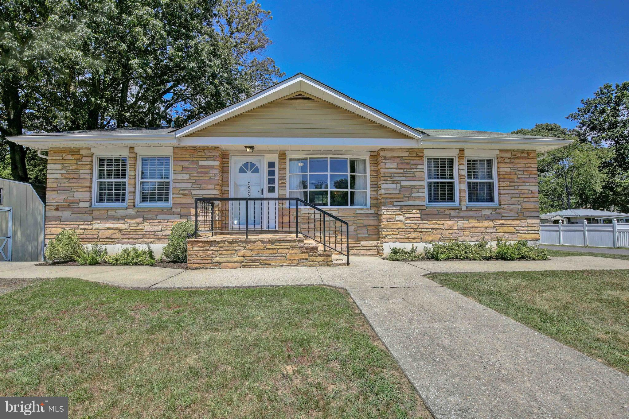 Three bedroom, one bathroom rancher with lots of natural light! Hardwood floors, stainless steel app