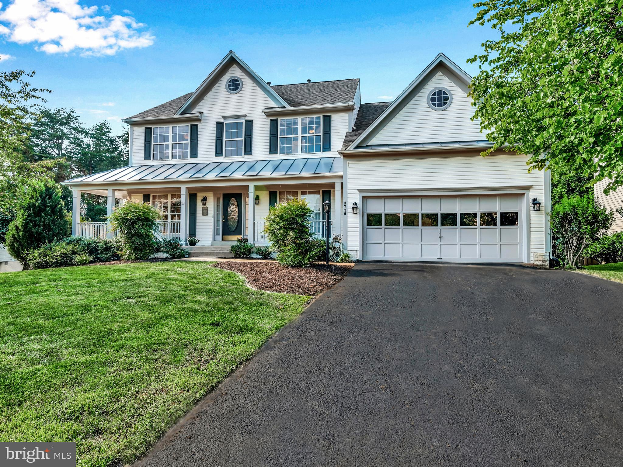 SPACIOUS Dalton Model Colonial in desirable Laurianne Woods offers 4000+ square feet of living space