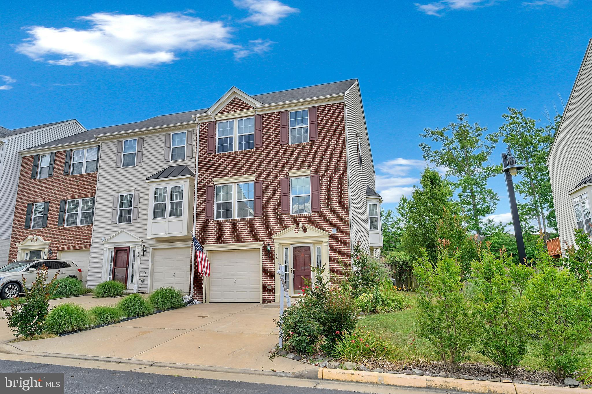 Photos will be made available.  Spacious end unit townhome in the lovely Woodstream community.  Beau