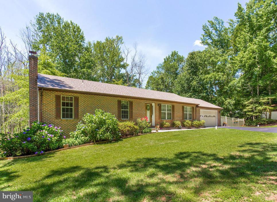 Well maintained rambler set on 3 beautiful acres of natural woods. Outdoor living space abounds. Fea