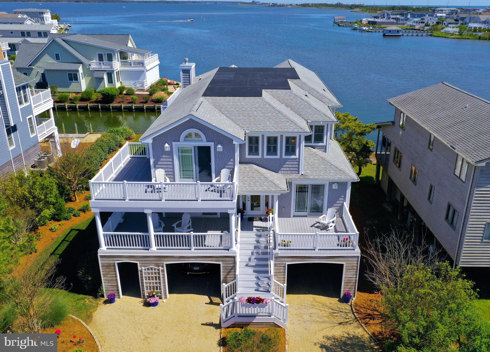 Stunning Bayfront home just a short walk to the beach with incredible panoramic water views. This co