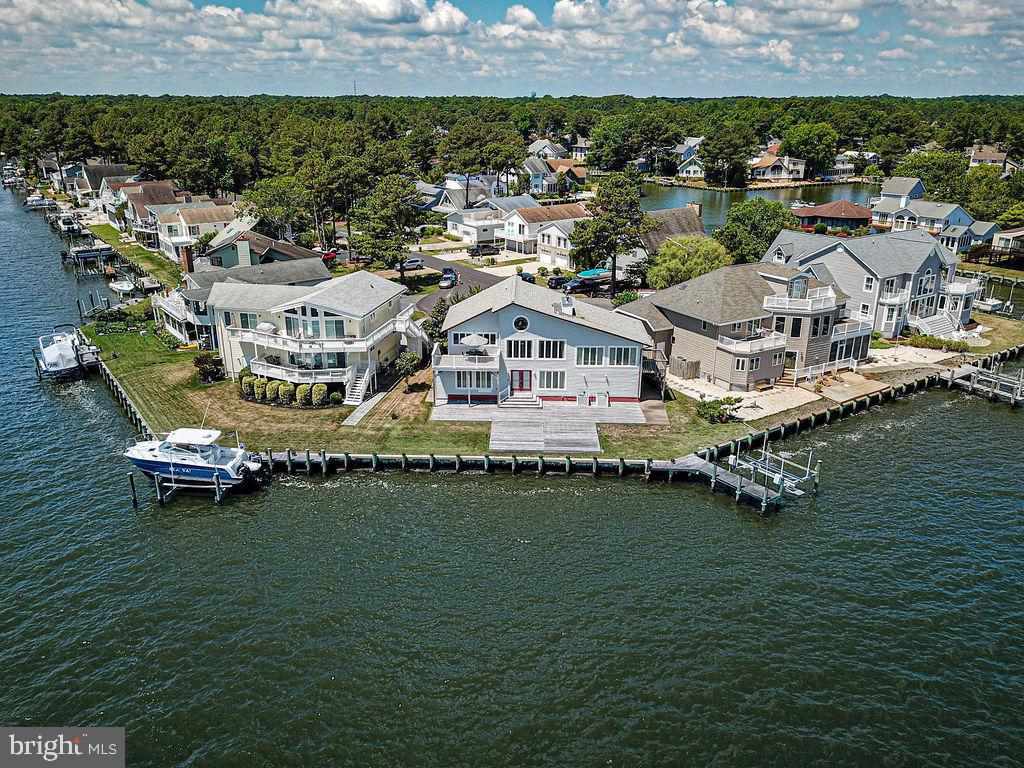 A MILLION DOLLAR VIEW PRICED TO SELL! Breathtaking Direct Bay Front with Panoramic Views Home in Ocean Pines, MD is ready for your immediate summer enjoyment. Once you enter this 3 bedroom 2.5 bath home you are truly amazed by the spectacular bay views from every window!  Greeted by soaring ceilings as you enter into the second level great room and chef style kitchen!  Entertain family and friends on the outside over sized Bay front Trek Deck or large Eat in Kitchen complete with granite counters, cabinetry with pull outs and newer appliances. Relax in an expansive Bay front Master Suite with panoramic views and private side door entrance!  The first floor boasts a large family room, mini kitchen, 2 bedrooms, one full bath and laundry. Exit out to a double deck as you walk out to your 115 feet of bulkhead and dock with boat deck. Other exceptional features include  two Crafted German wood/coal stoves,   two stain glass windows,  Custom exposed wood beams,  outdoor shower, newer roof, newer windows, newer furnace and new bulkhead,  , encapsulated  crawl space and 2 car garage! Long concrete driveway at the end of cul de sac is perfect location for privacy. Don't miss out on this captivating home. This home isn~t going to last ~ schedule your showing before it is gone