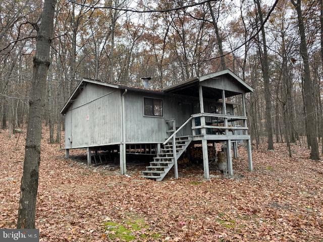 Adjoining, Sleepy Creek State Forest, this 9.97 Acre parcel is a rare opportunity for your Getaway Home or perfect for a Hunt Club.  Small Cabin with Electricity (NO WELL or SEPTIC).