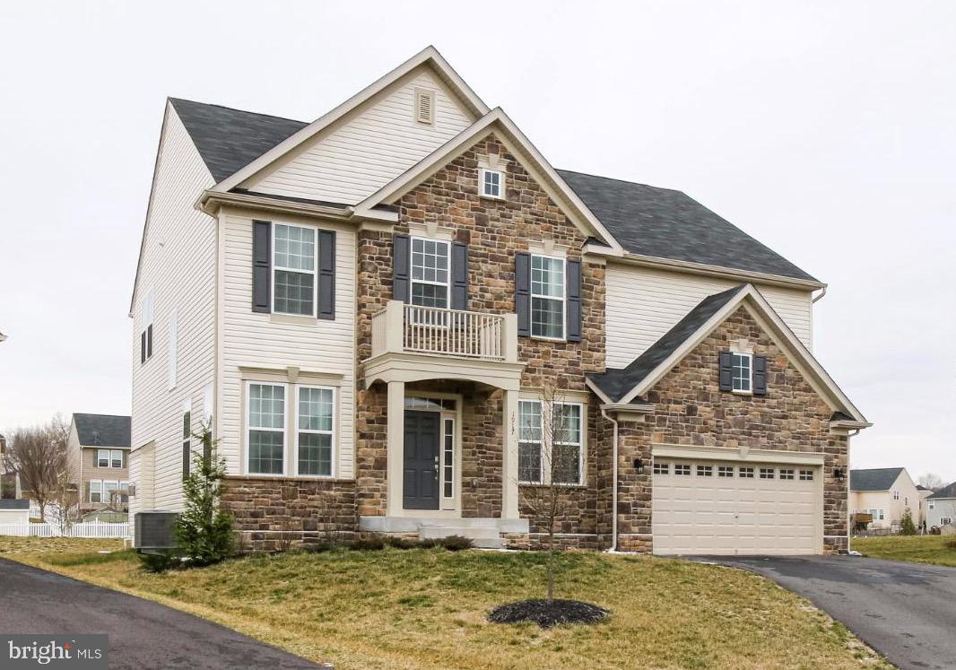 """New adjusted price!  This home shows just like a model home.  Amenities include upgraded hardwood floors throughout the main level living areas, dark cabinets, high end  countertops, upgraded SS appliances, gas cooktop and tile backsplash with oversized island.  All open to the great room with plenty of room for an eating area along with gas fireplace in the adjoining family room.  Butler's pantry leads into the formal dining and living room.  Upper level consists of 3 full baths, 4 bedrooms and an open loft area that could become a 5th bedroom if desired.  Fully finished basement with oversized recreational room, media room, full bath, room for another """"bedroom"""" or office space and has interior & exterior access.  Clover Ridge is a great neighborhood with plenty of sidewalks and community pool for all to enjoy."""