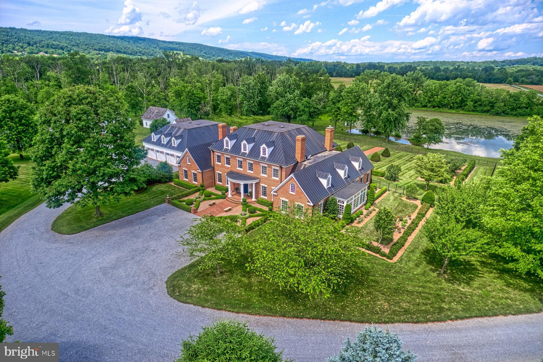 Welcome to Monte Subasio, a sophisticated estate on 23 lush acres in beautiful Bluemont, Virginia. T
