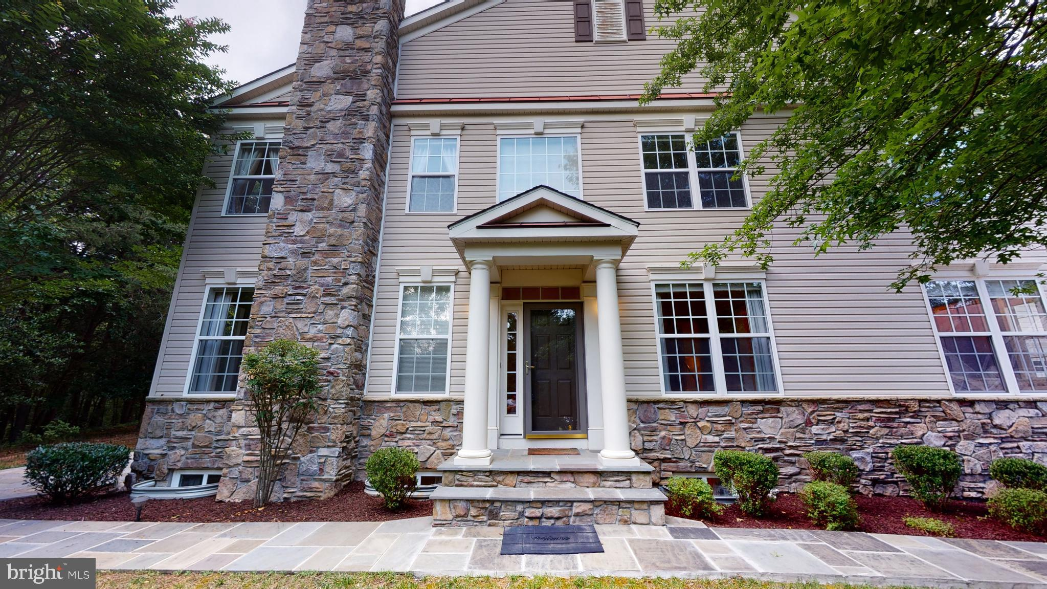 MUST SEE Luxurious End unit, Villa Style town home in the highly desired Piney Orchard area of Odenton.  This beautiful home features 4 Bedrooms, 5 Baths, 2 car garage, and over 3,600 sqft of finished living space on a premium lot with no age restriction. Upgrades galore, this home has Gourmet Kitchen w/ Corian Countertops, Brand New SS appliances, fresh paint, beautiful hardwood floors, recessed lighting, crown molding, two gas fireplaces, and a new stone/patio walk walkway.  The main level features an owner~s suite with a full bath, living room, dining room, kitchen with island, a half bath and a walkout to the patio. Upstairs you have a second master suite with dual vanities, sep tub and shower combo, large walk-in closet and two additional bedrooms and a family sitting area. The finished basement features, full bath, stacked stone fireplace, a large open area and additional storage space for the family.   The Home backs to woods leading to a nature preserve, with easy access to walkways and jogging paths.  The community features 3 outdoor swimming pools, heated indoor pool, hot tub, fitness center, tennis courts, a community center with library and party room.  The community retail center includes a grocery store, several restaurants, coffee shops, salons and more!  Just minutes to Ft Meade and MARC Train, with easy access to DC and BWI.  Hurry, book a showing today and make this home yours, this one will not last!