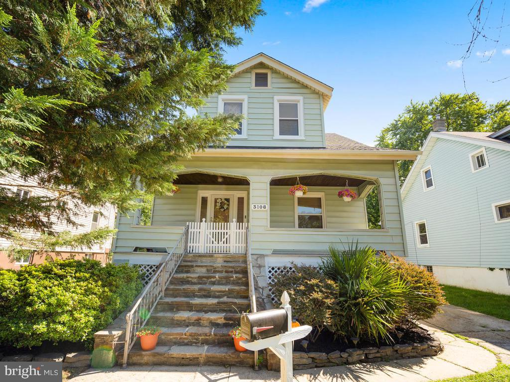 Adorable 3 bedroom, 1 1/2 bath craftsman style home featuring 3 finished levels and a beautiful fron