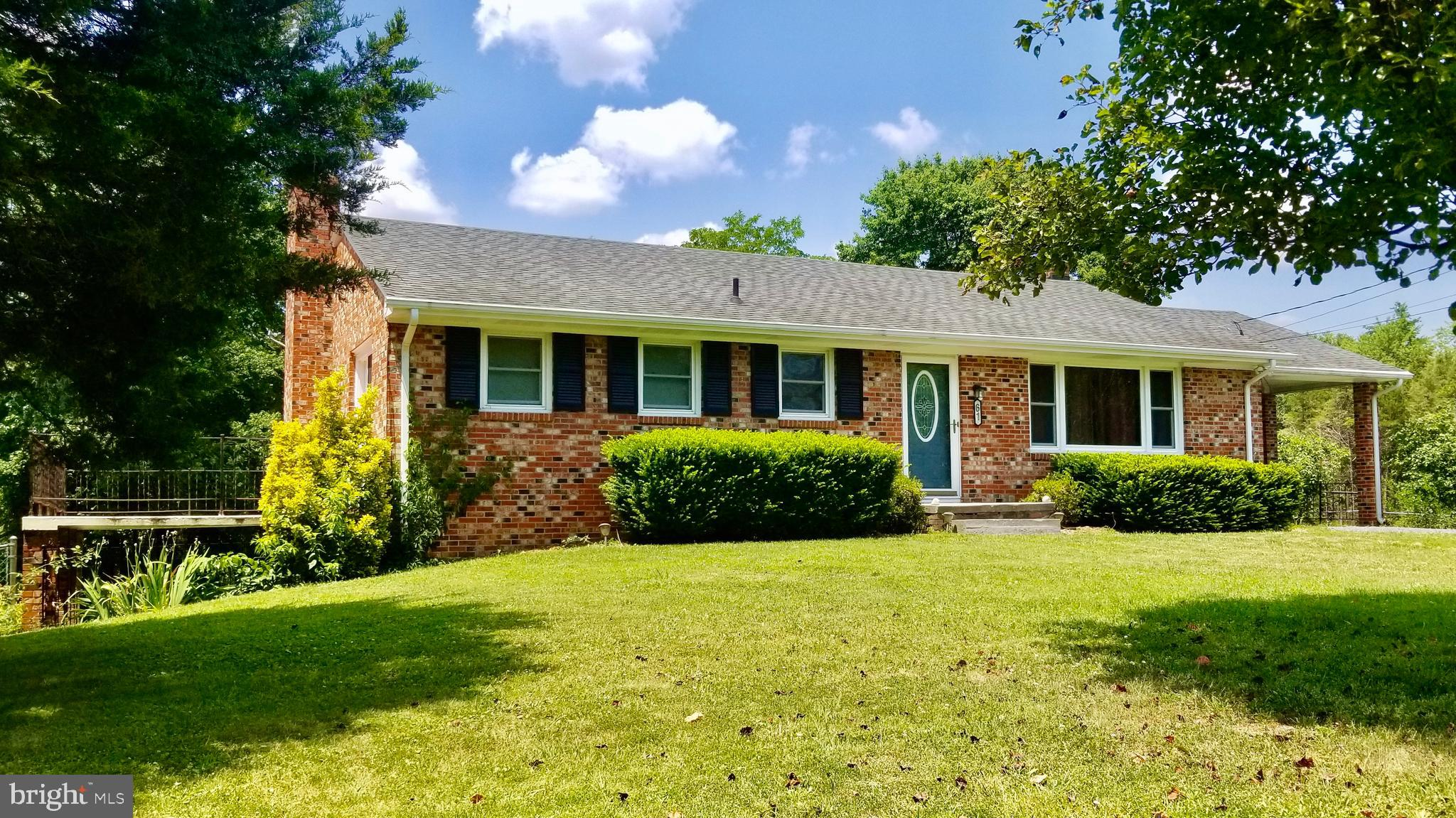 Beautifully updated brick rancher on premium half acre lot with main level master bedroom and walkout basement!  Quietly located on a no-thru street, but convenient to I-66, this stunner offers an open kitchen with new laminate flooring, upgraded designer cabinets, stainless steel appliances, propane gas stove, pantry, and quartz countertops, large windows with lots of natural light, ceiling fans in every bedroom, refinished hardwood floors.  Master bedroom with double closets boasts its own private 27' balcony to enjoy your morning coffee while listening to the birds singing from the beautiful evergreens and flowering trees.  12 x 27 covered patio for outdoor entertaining adjacent to the huge fenced yard.  Main level bathroom with double vanity and wainscoting. Partially finished, walkout basement with lots of natural lighting is the perfect space for game night and entertaining in the 23 x 13 den, carpeting has been replaced, full bathroom with stall shower, wood stove with custom stone surround with storage space for stacked wood.  Covered attached carport with wheelchair ramp accessibility, storage shed, water treatment system.  Water heater, washer, and dryer are less than 4 years old.  Brand new outdoor a/c unit.  Xfinity high speed internet available.  Total acreage includes additional lot, Tax ID 18A 1 2 8.  Check out the virtual tour! Warren County, VA