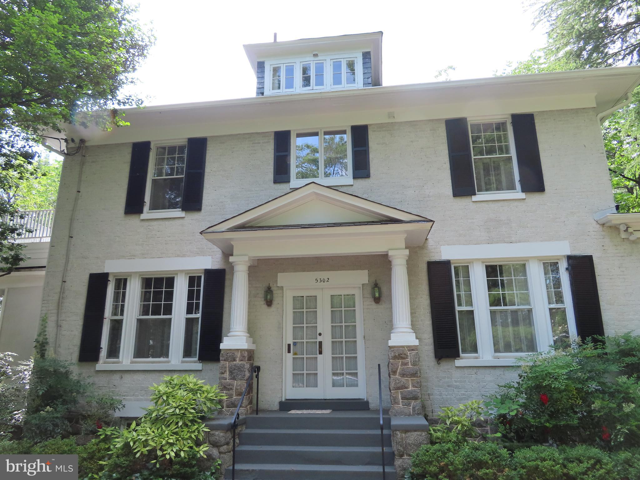 This gracious home offers stature  from circa 1922.   From the  circular drive up the steps to the s