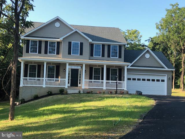 Over 2 acres in the country with a brand new well built colonial home with a full basement. What mor