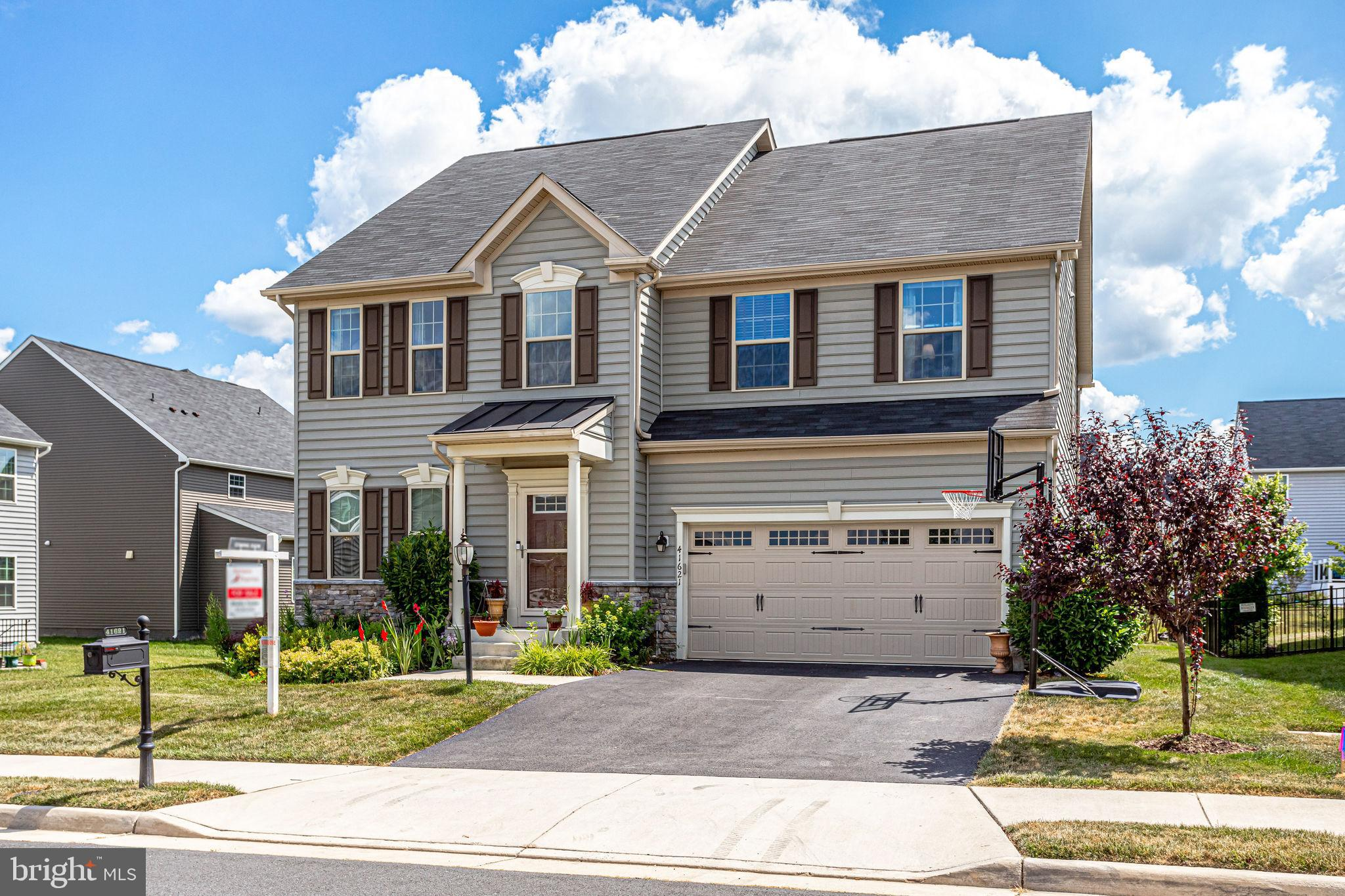This upgraded Ryan Naples floor plan four (4) bedroom, 3.5 bathroom home is only 6 years old and is