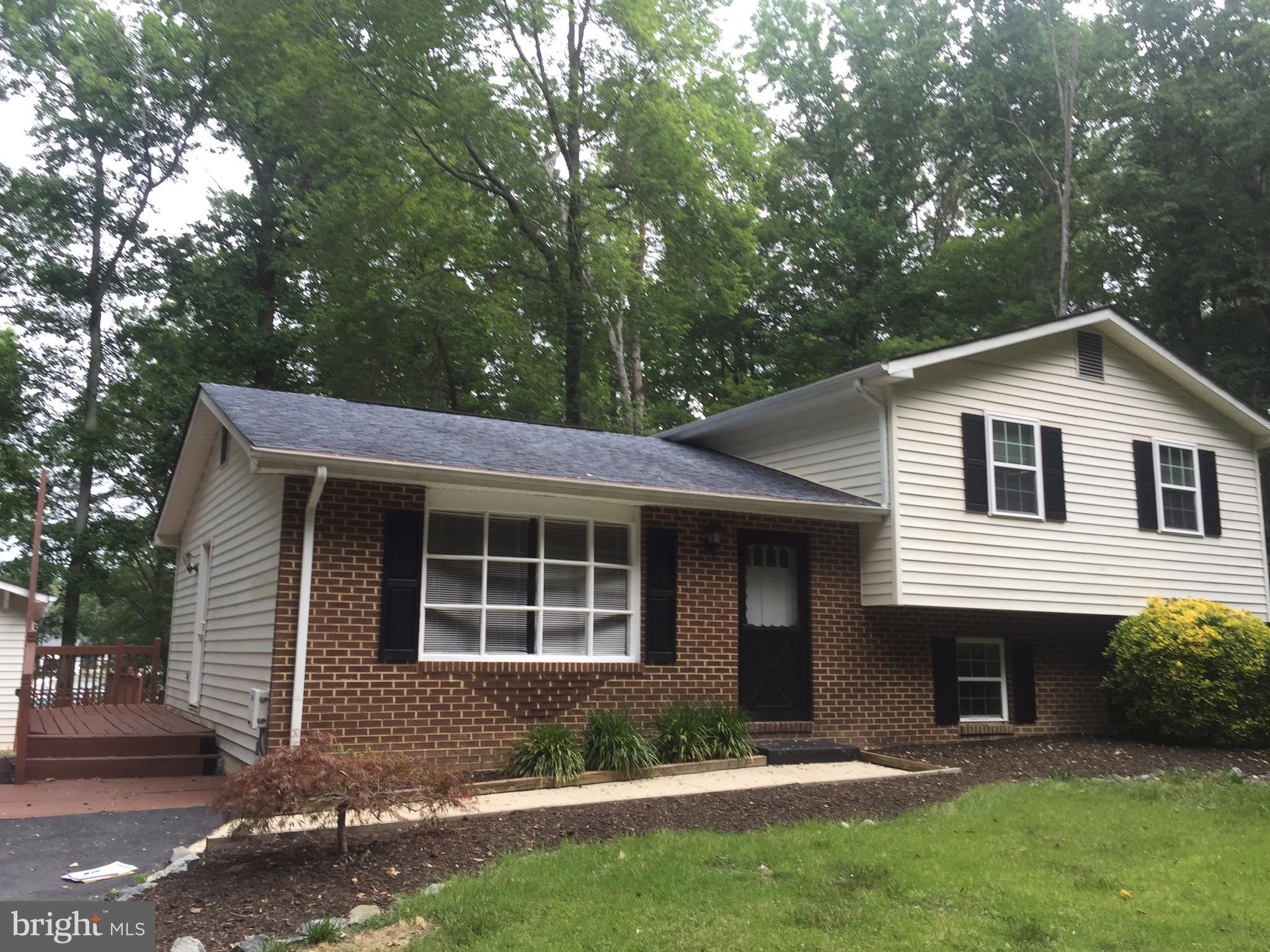 Back on the Market!  Large split level brick front sitting on .5 acre!  You can see the water from y