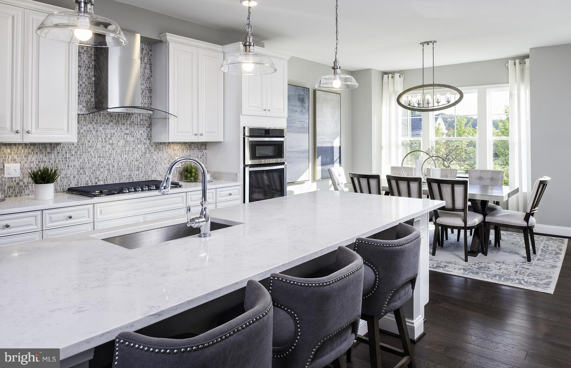 MODEL HOME FOR SALE! This gorgoeus updated Home features a Gourmet Kitchen with Stainless Steel, Whi