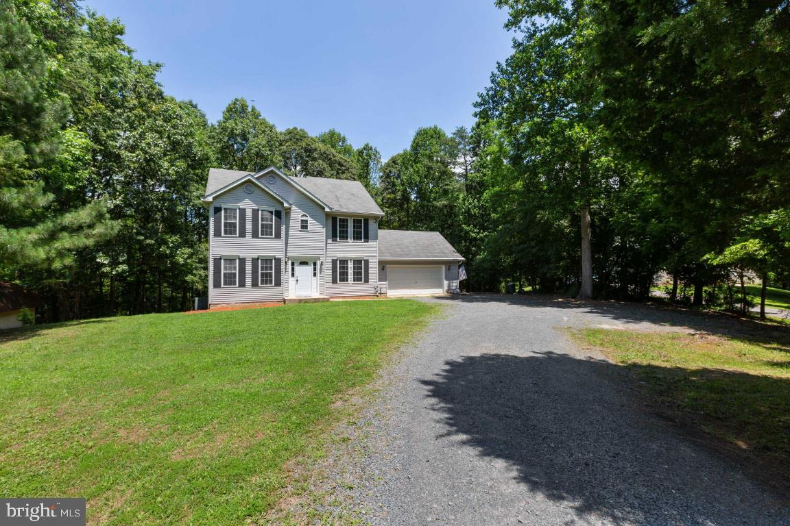 Fabulous, move-in ready home, with attached 2 car garage! 2.6 acre lot (You read that correctly -- 2