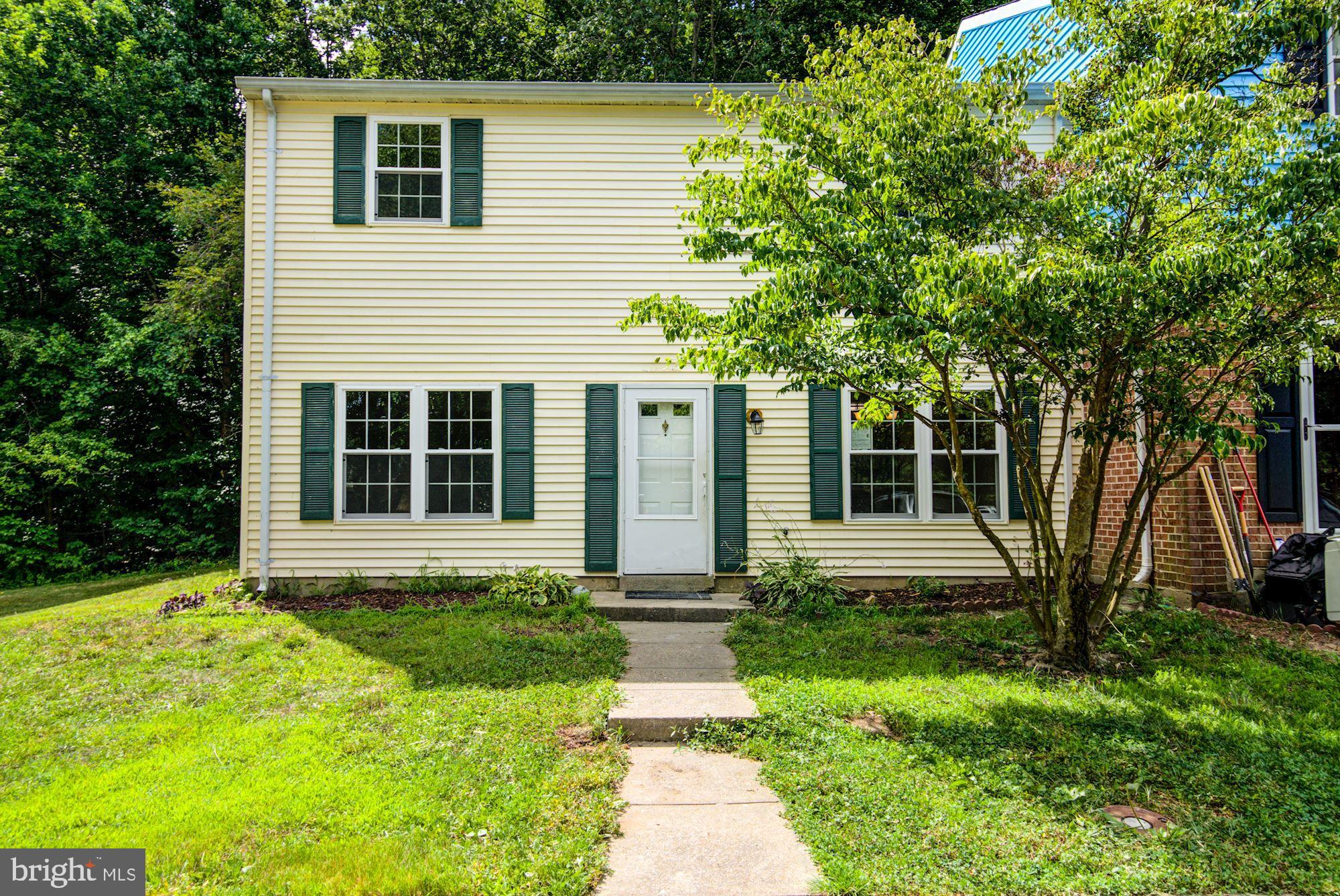 Fully Remodeled END UNIT Townhouse with 3 bedrooms and 2.5 baths! All NEW flooring, paint, cabinets,