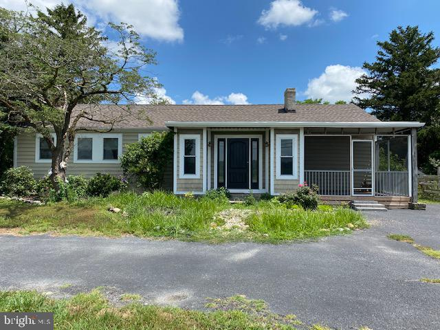 This property is a true fixer-upper on a large lot right outside the town of Milton and would be gre