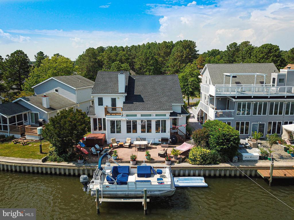 DIRECT WATERFRONT HOME  offers magnificent panoramic views of the open water! This custom designed h