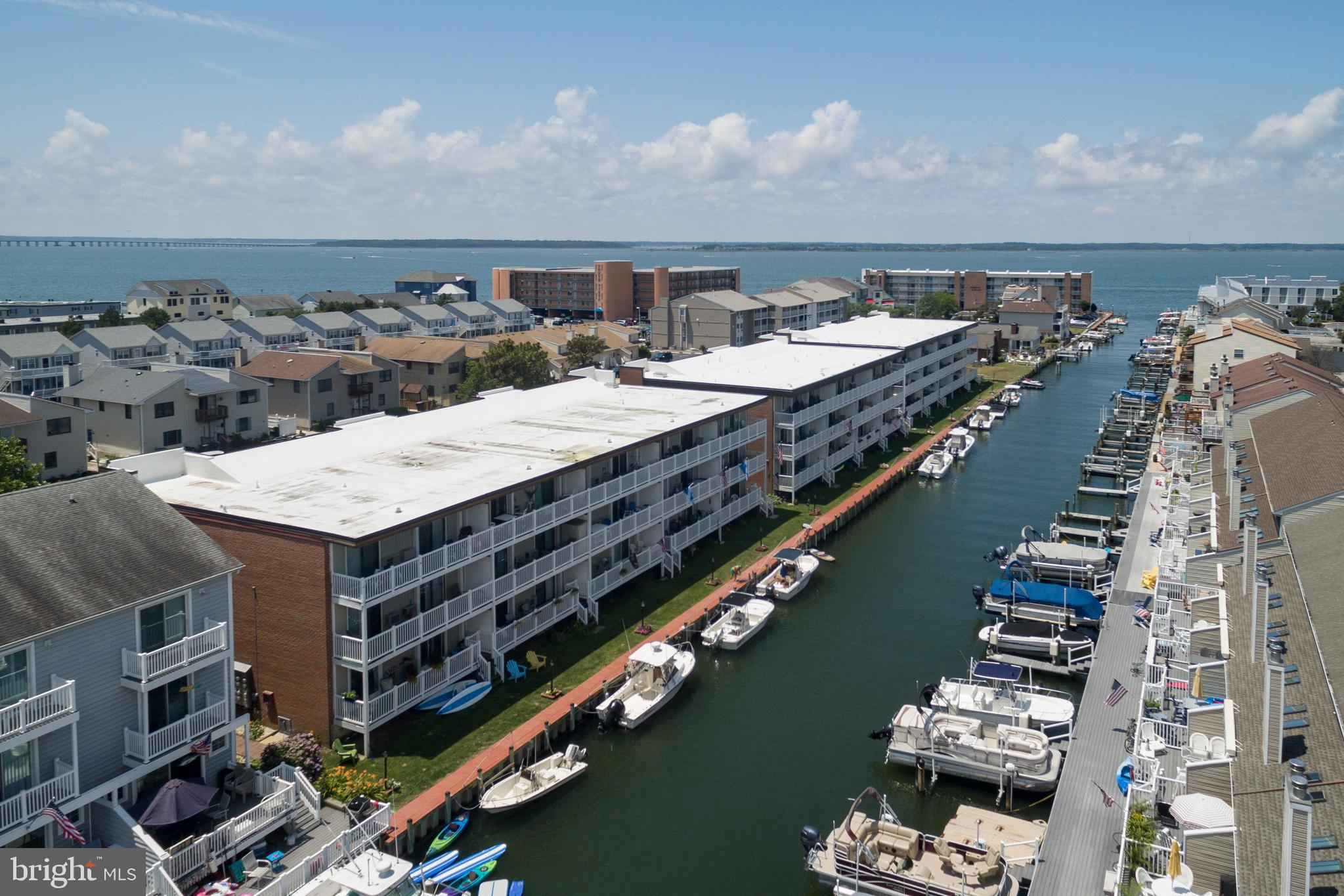 You've found it - Your magnificent new waterfront beach condo! This 2 bed/2 bath top floor unit shows great with new vinyl plank flooring, a new wet bar, updated bathrooms with new tile and more. It's ready to move right in! Just picture yourself sitting on your balcony, watching sunsets and boats. Or seasonally rent a slip from condo association for $150 (based on availability) and take your boat out and enjoy! Private exterior storage closet. One reserved parking spot and visitor spots available.  Professionally managed condo association. Exterior building updates include new roof, canal bulkhead (2019), parking lot (2018), vinyl siding (2017), vinyl railings (2015). Chateau Phoenix complex is located of popular 94th Street community, close to plenty of restaurants, shopping, entertainment and grocery. Owner used as family residence, but would also be a great vacation or rental. Call for your private tour today!