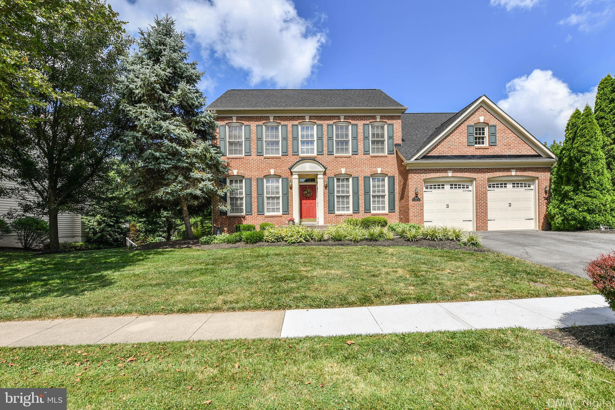 This beautiful brick front colonial is located in the golf course community of Holly Hills.  This ho