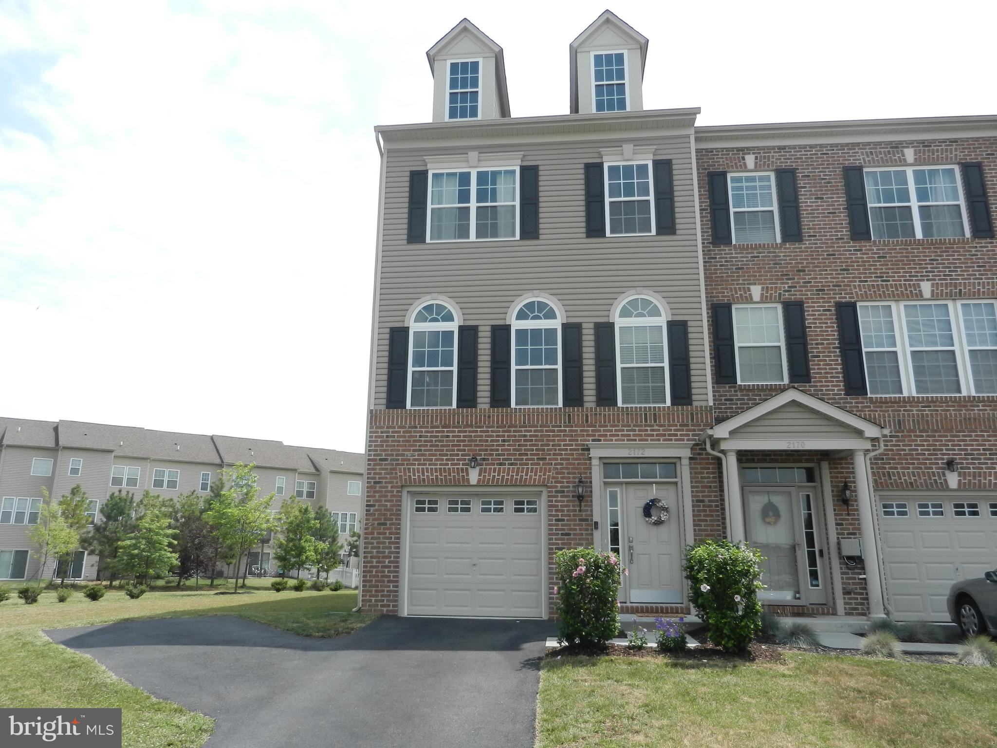 Meticulously maintained end unit townhome in the highly sought after Village of Bayberry.  Lower lev