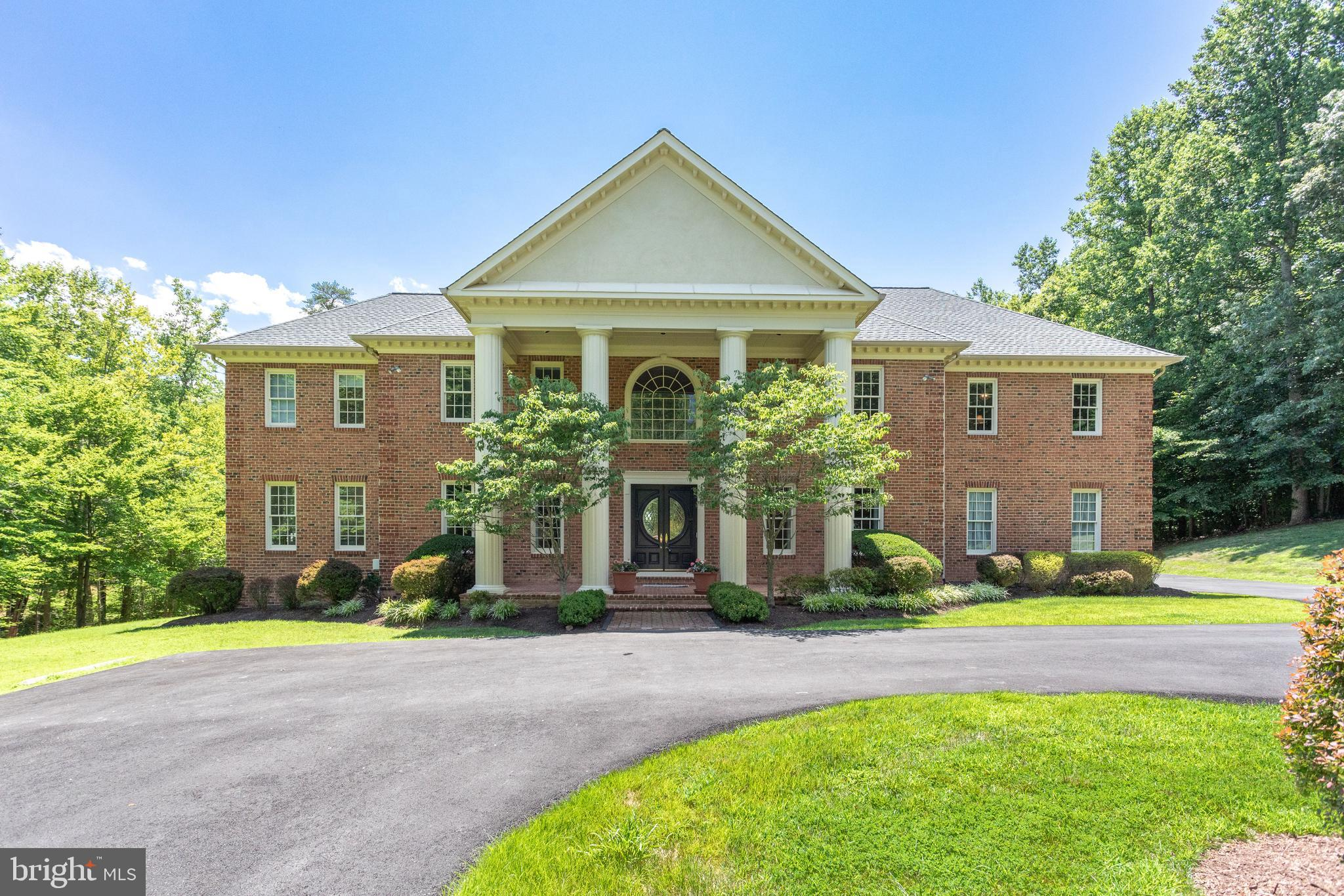 PRESENCE, PARADISE AND PRIVACY! Stately brick colonial mansion nestled on a beautiful 5 acre setting
