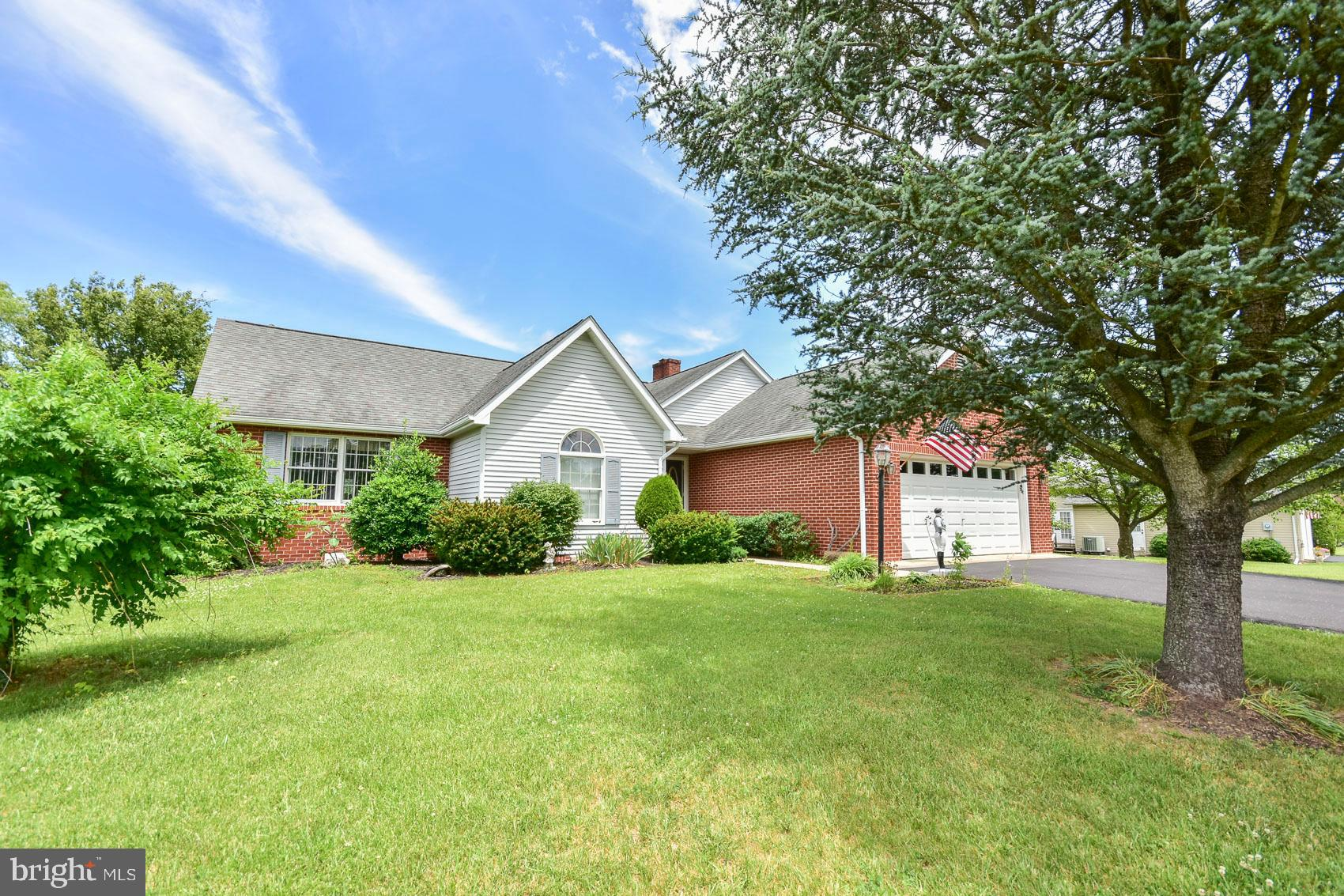 An Exceptional Brick Rancher with 1654  Square feet on a lovely half acre lot is now available in ve