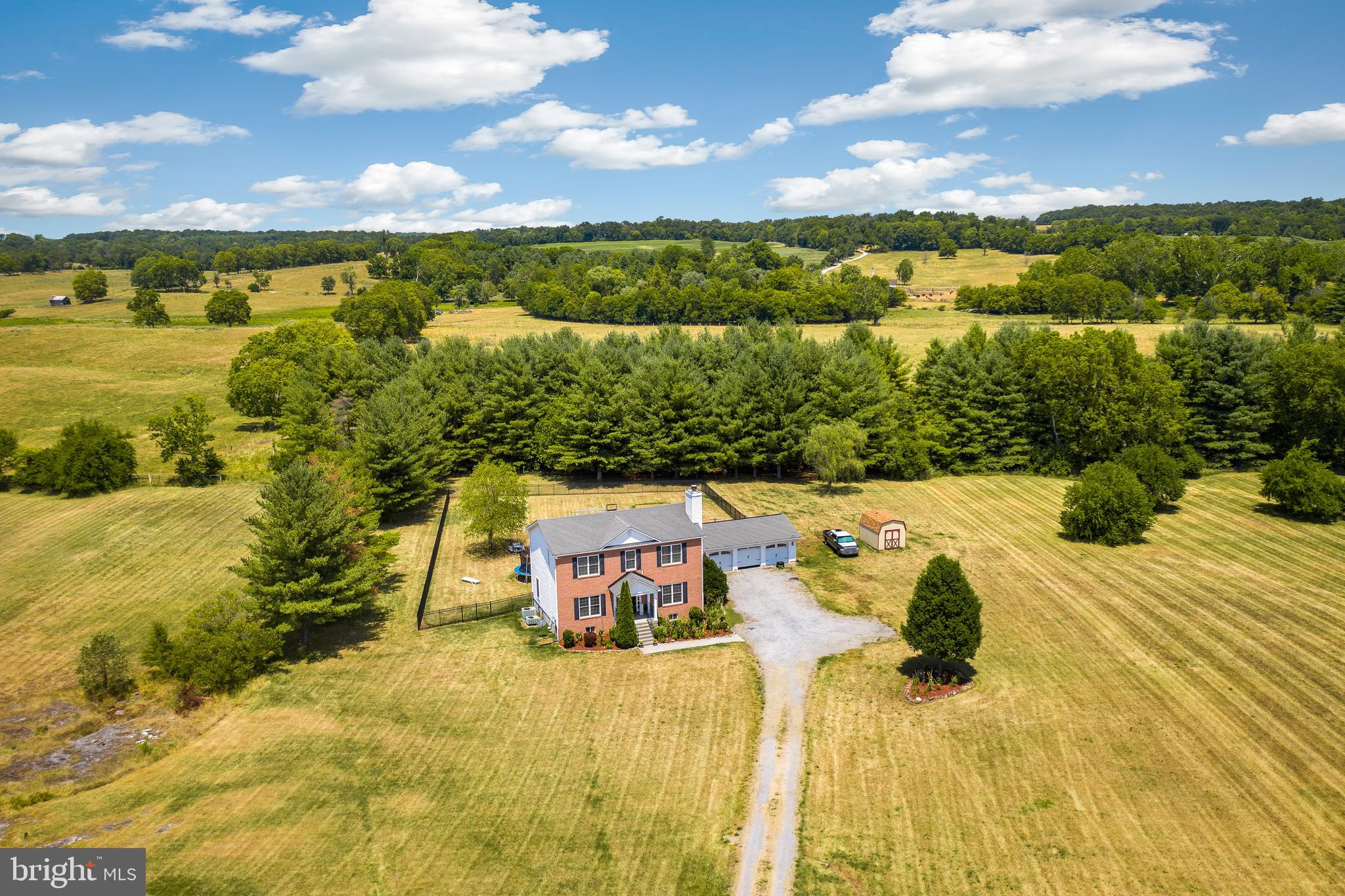 Welcome Home!  This wonderful Estate sits on 5+ acres with views that go for miles and miles!  It is