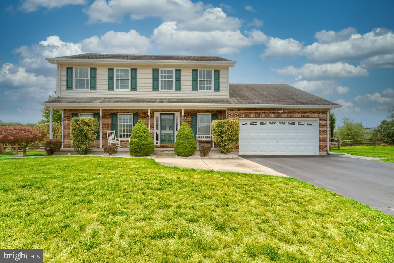 Welcome home to 11 Biltmore Ct. Located in Mansion Farms, this quality built RC Peoples home has bee