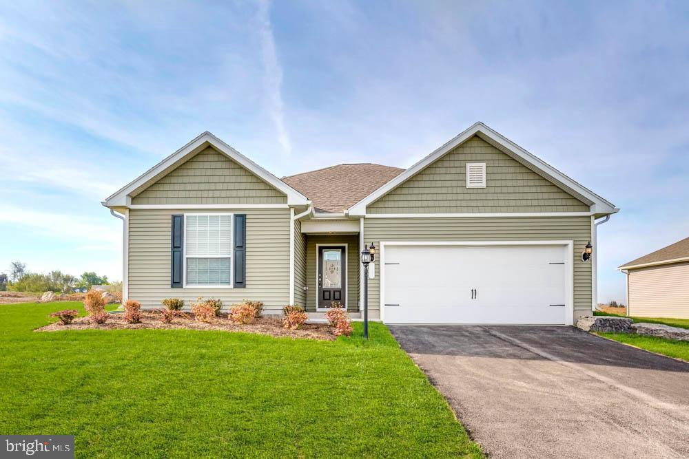 The beautiful Martin plan from LGI Homes features an open floor plan with 3 bedrooms, 2 baths, a lar