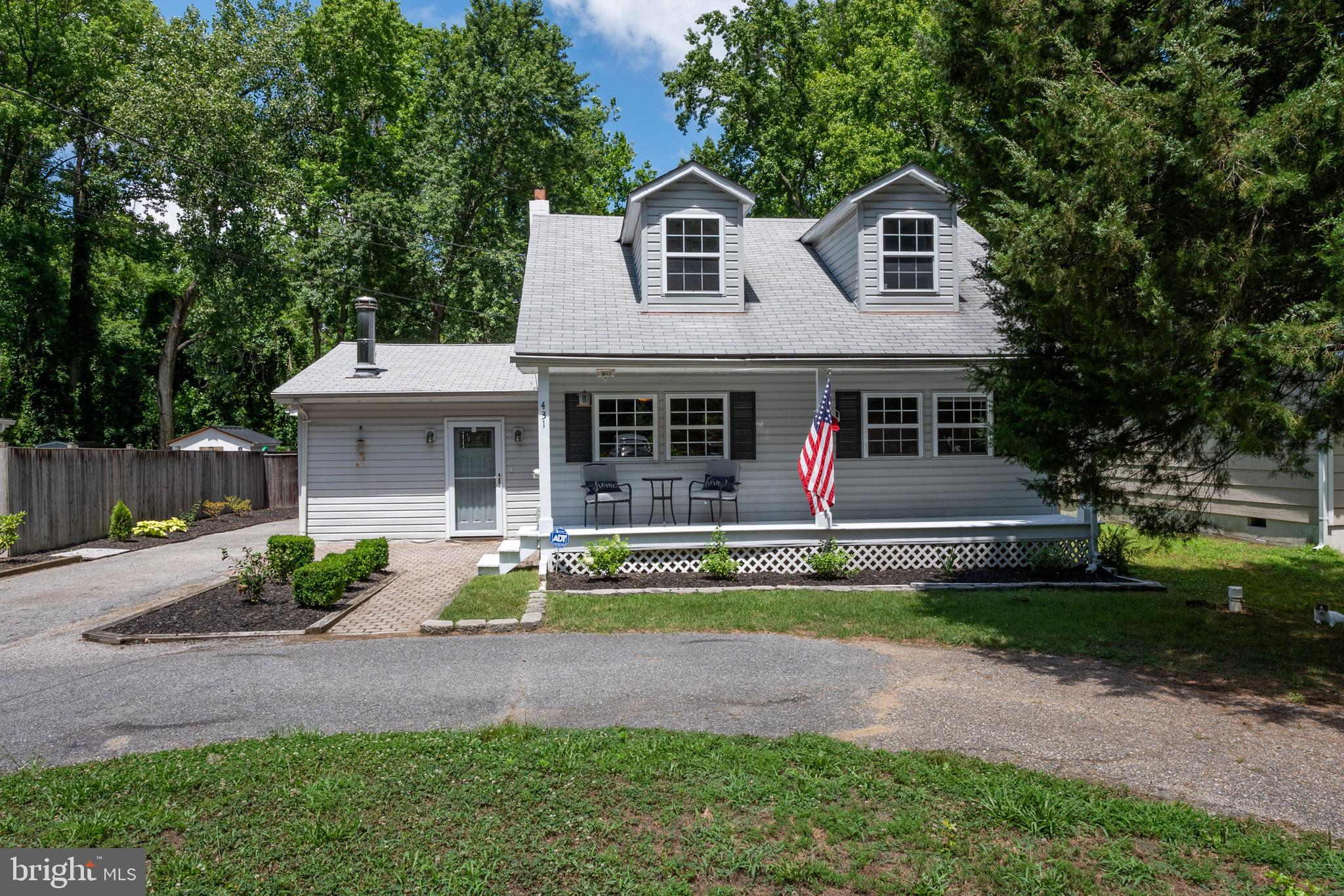 Adorable Cape Cod home located in the desirable neighborhood of Loch Haven.  This house has been upd