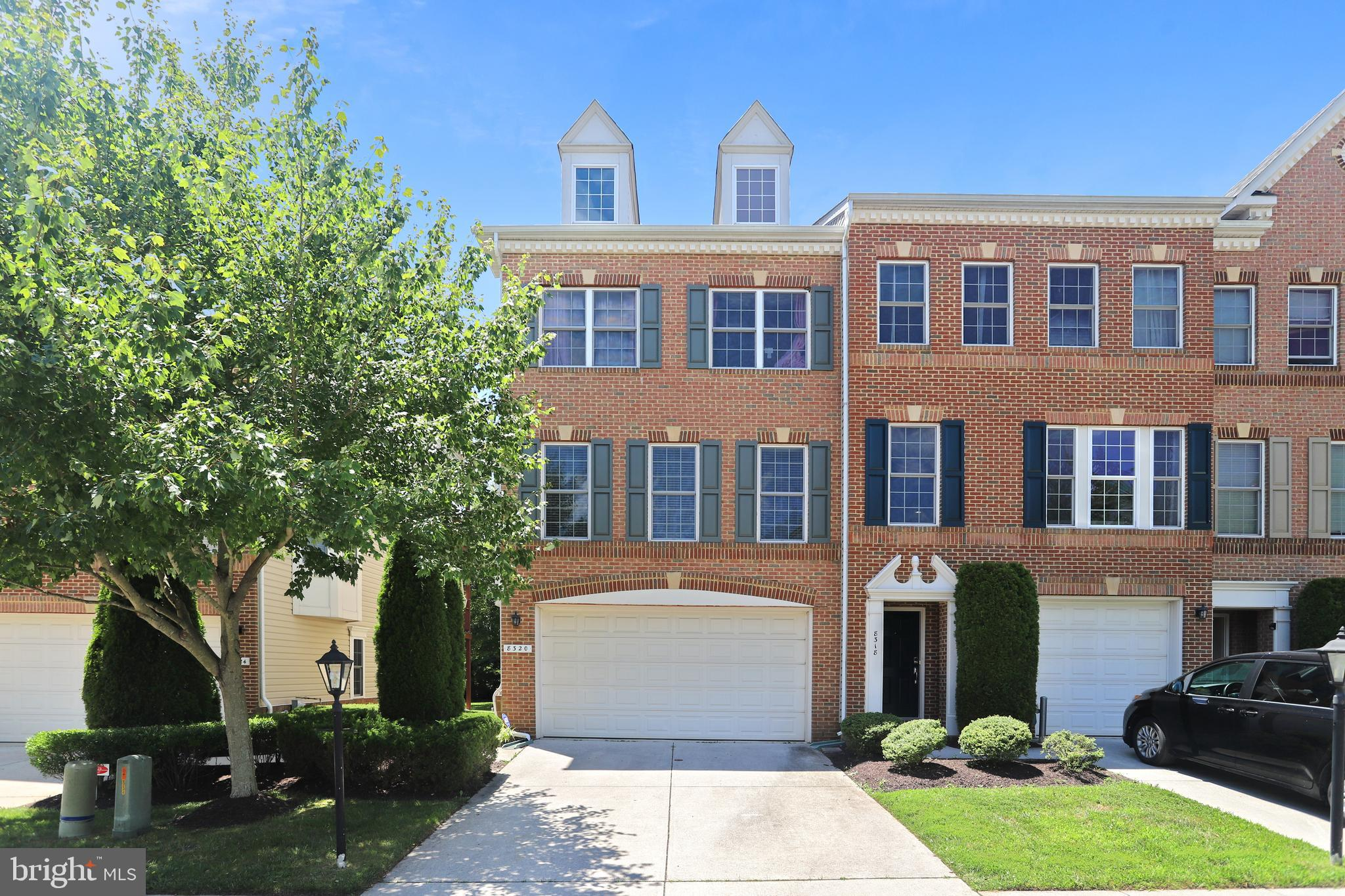 A MUST SEE! Gorgeous 3 BR/ 2 Full & 2 Half BA Brick-Front & Side END-UNIT Townhouse with 2 car garag