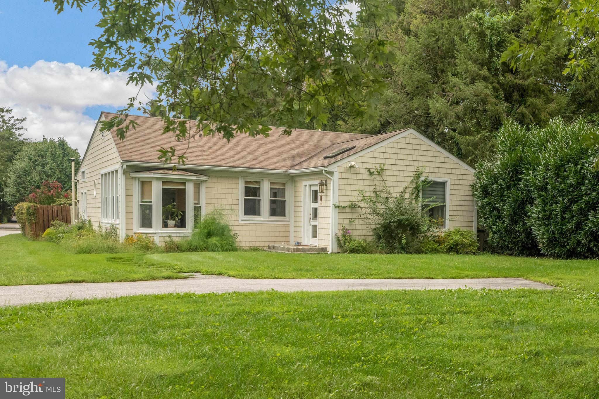 Bright and open one-level living located in serene country setting.  Wonderful combination of open f