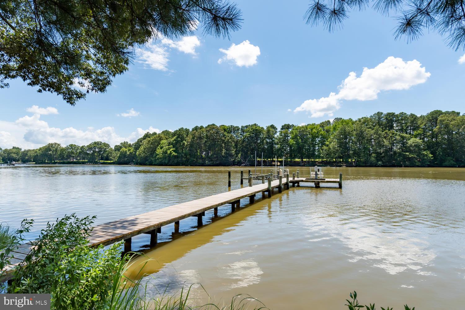 This  Wye River waterfront feels like home.   Enjoy peaceful water views throughout this custom buil