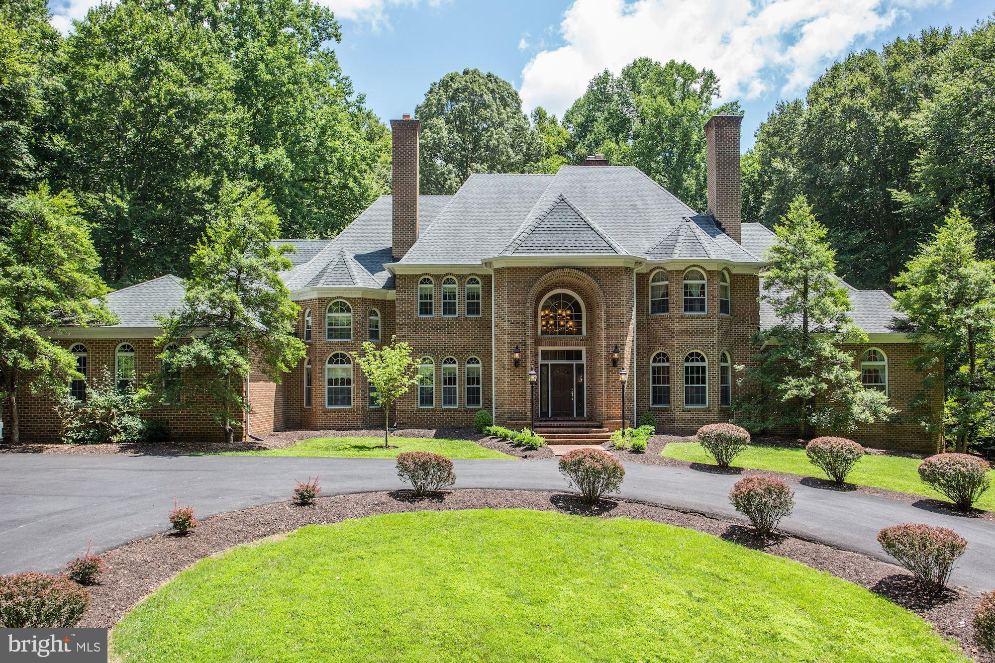 167 Yarnick Road is a remarkable and beautifully crafted Country Manor that echoes the influence of