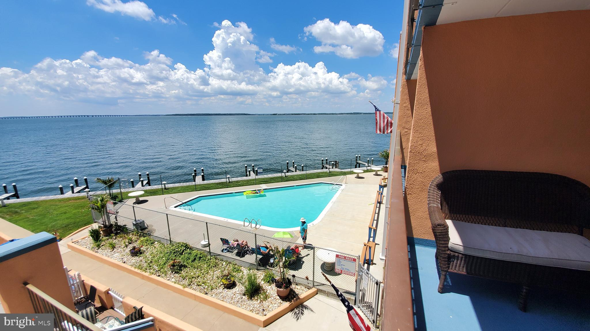 Direct Bay Front masonry condo with amazing bay views from living room and kitchen! Enjoy the sunset