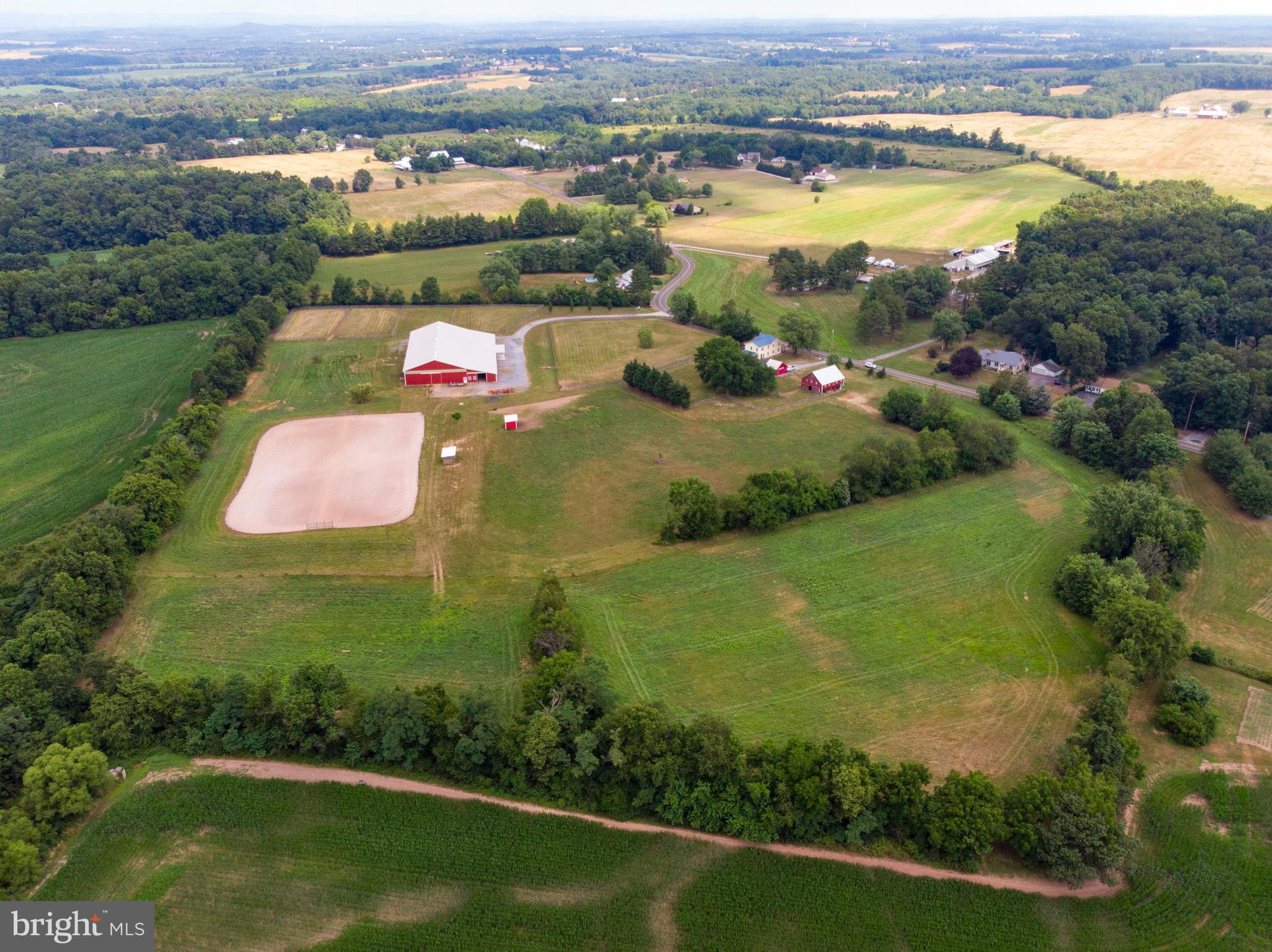 Come home to everything you'd want for your turnkey farm or equestrian facility! 21 acres of flat, f