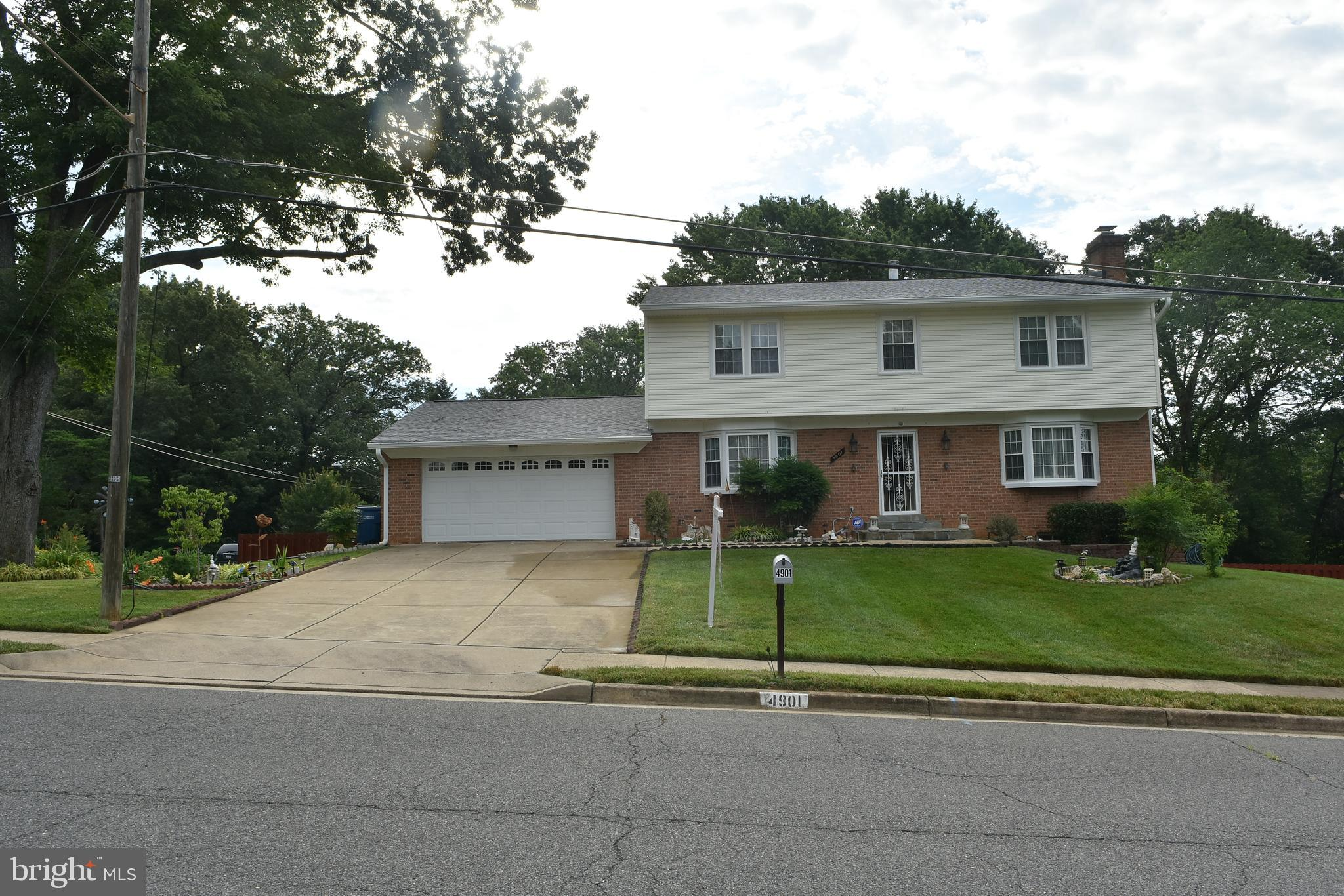 Great Location ! 3 Level Colonial with 2 large car garage, 4 BRs, 4BAs ( 2 full & 2 Half) on the big